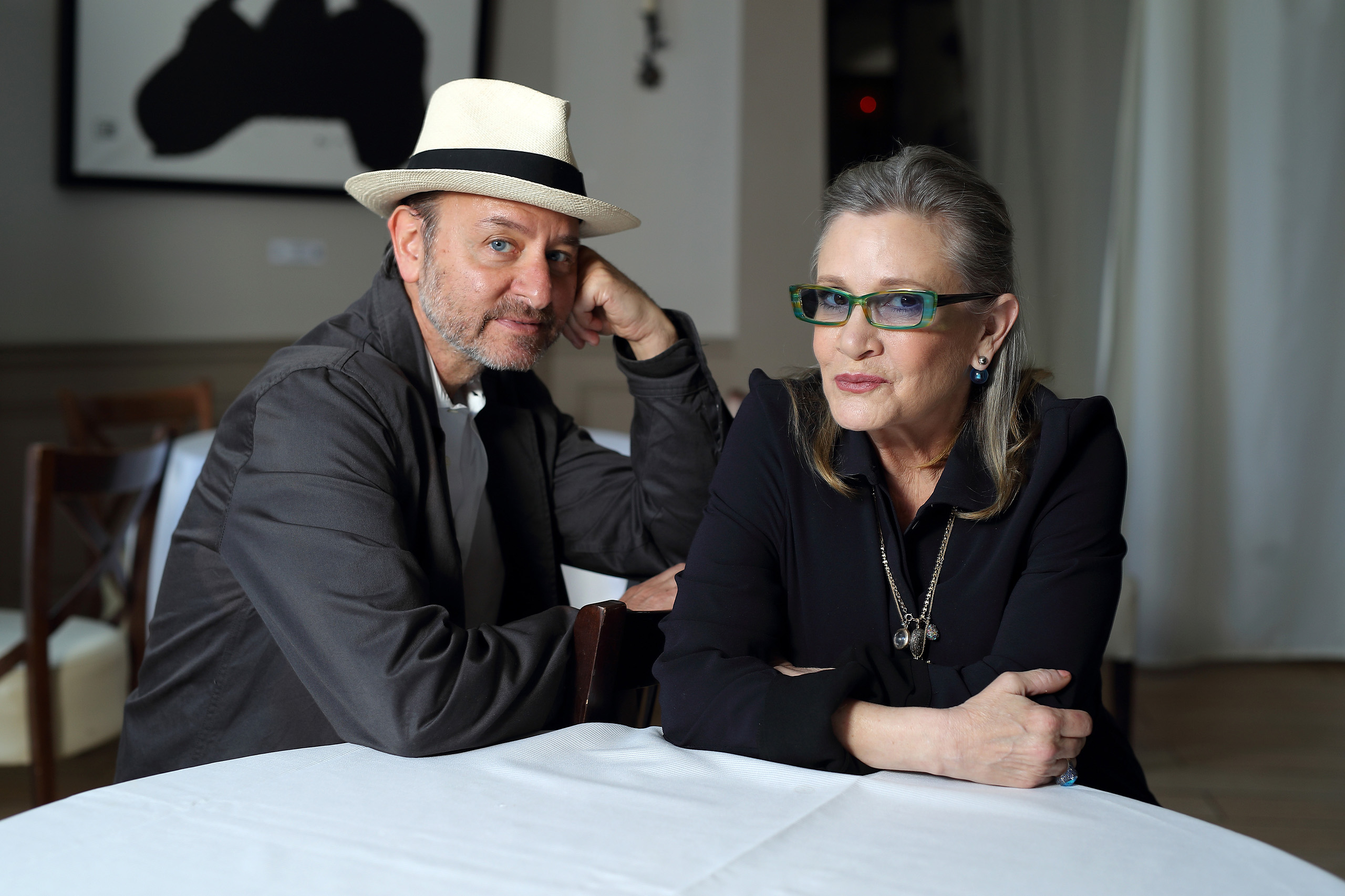 Carrie Fisher and Fisher Stevens attend a photocall for  Bright Lights  during The 69th Annual Cannes Film Festival in France on May 15, 2016.