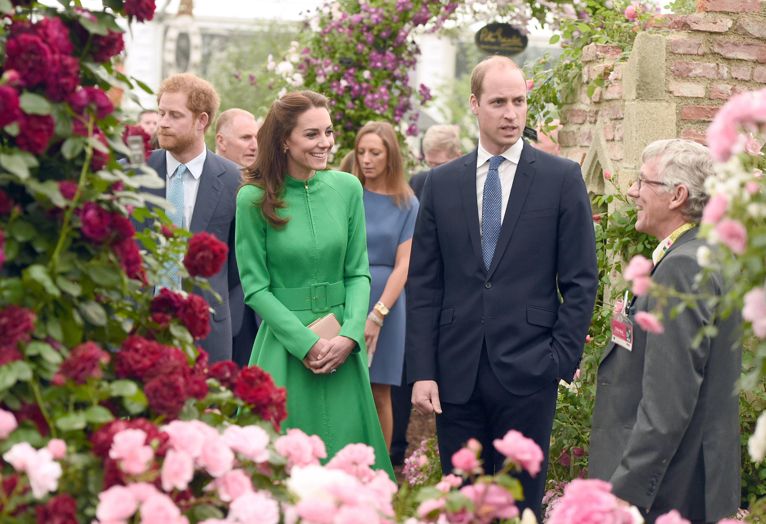 Prince William and Catherine, Duchess of Cambridge, are joined by Prince Harry during a visit to the 2016 Chelsea Flower Show in London on May 23, 2016.