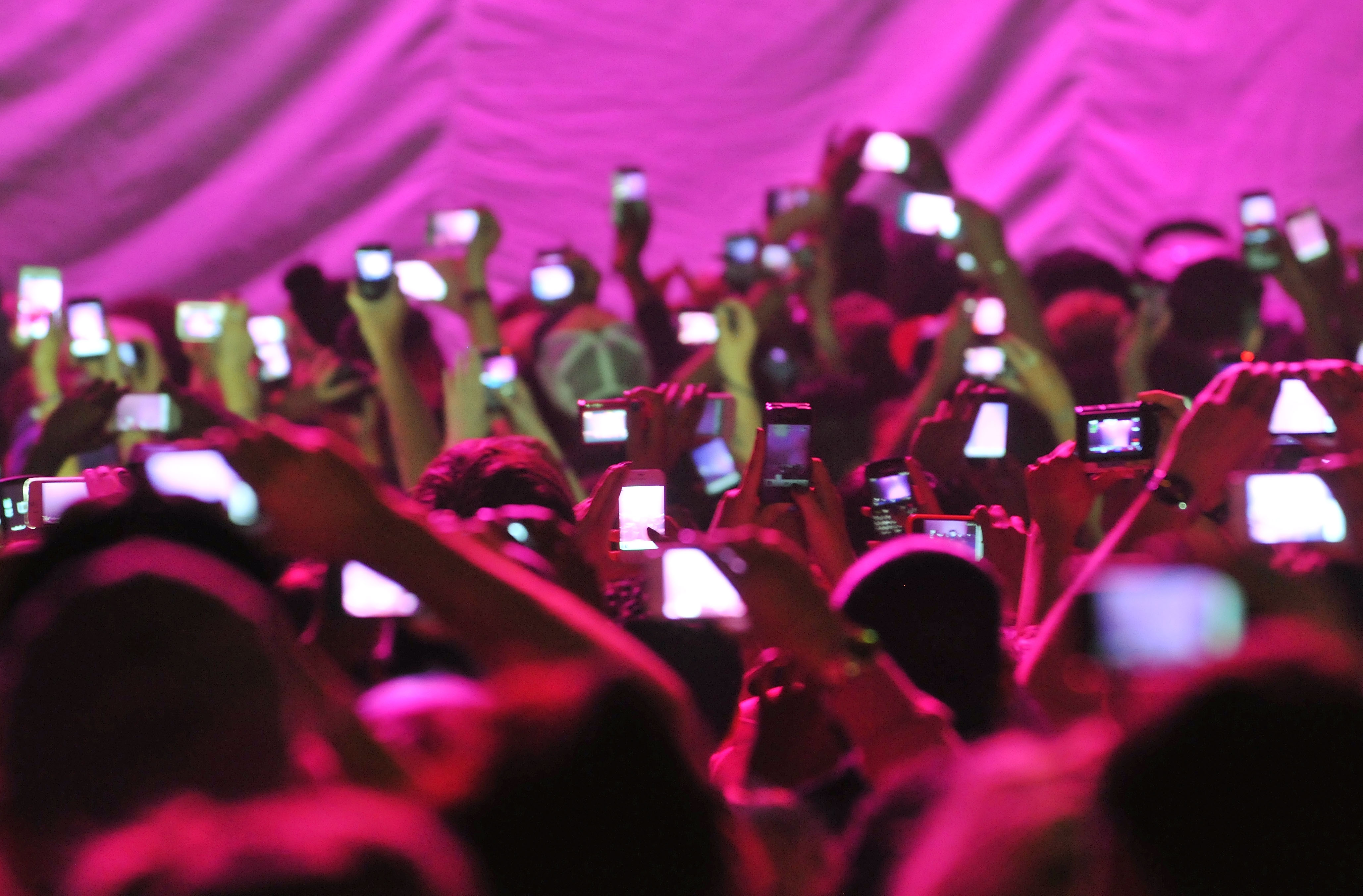 Members of the audience hold up cameras and mobile telephones as American rapper and R&B singer Nicki Minaj takes to the stage stage during her 'Pink Friday' tour at HMV Hammersmith Apollo on June 24, 2012 in London, United Kingdom.