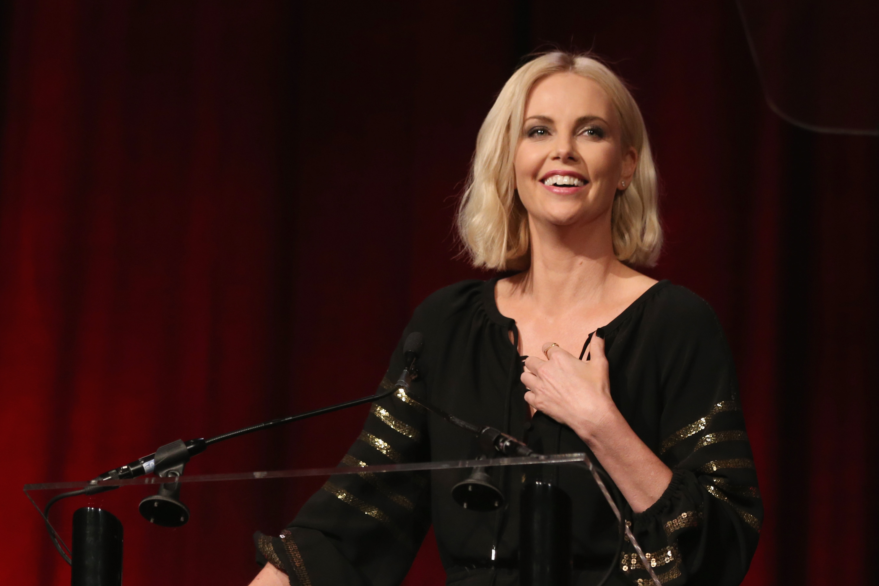 """Actress Charlize Theron speaks onstage during the 2016 Will Rogers """"Pioneer of the Year"""" Dinner Honoring Donna Langley at Caesars Palace during CinemaCon, the official convention of the National Association of Theatre Owners, on April 13, 2015 in Las Vegas, Nevada."""