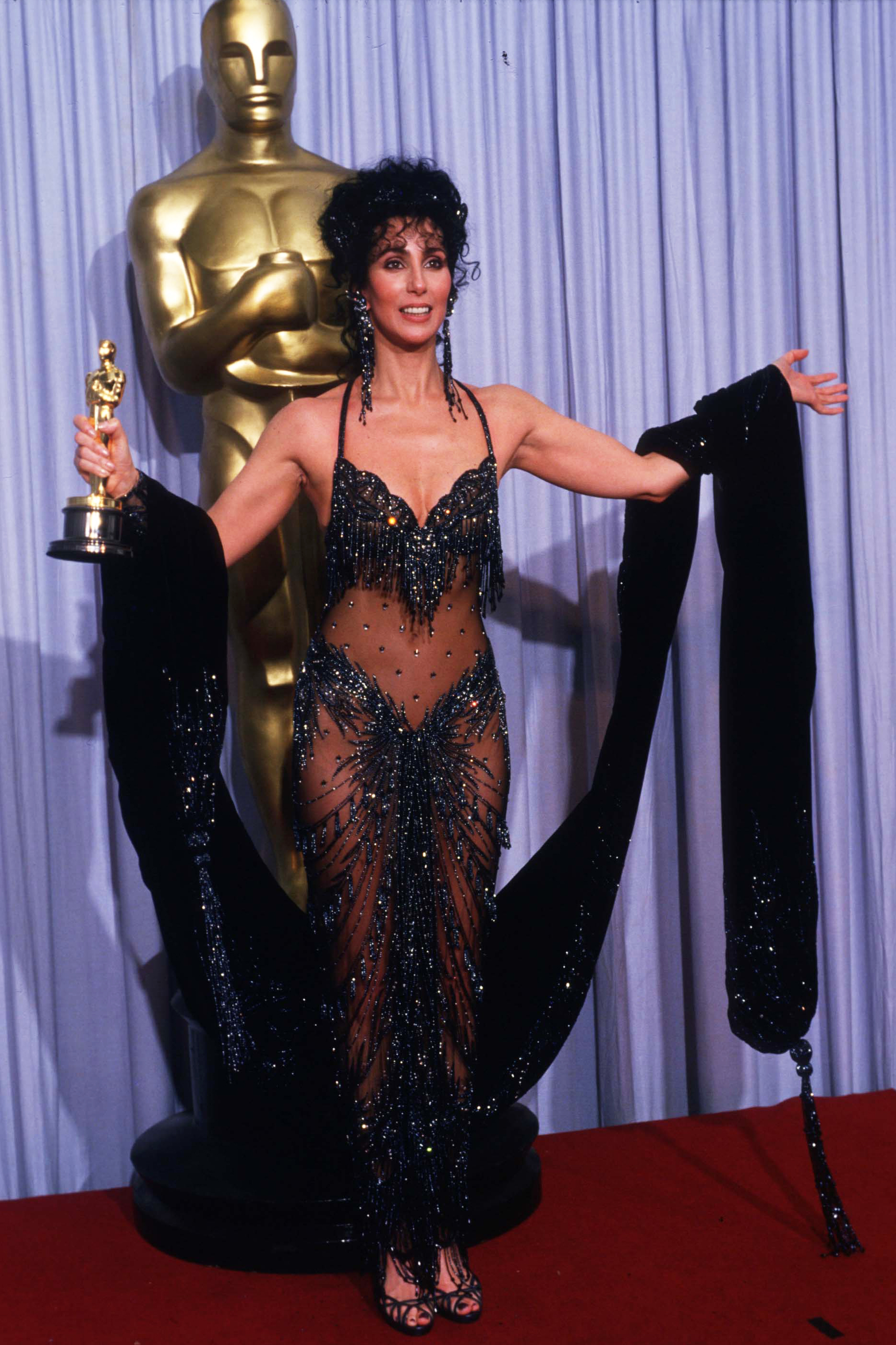 Cher holds her Oscar for Best Actress in a Leading Role Oscar for Moonstruck in Los Angeles on April 11, 1988.