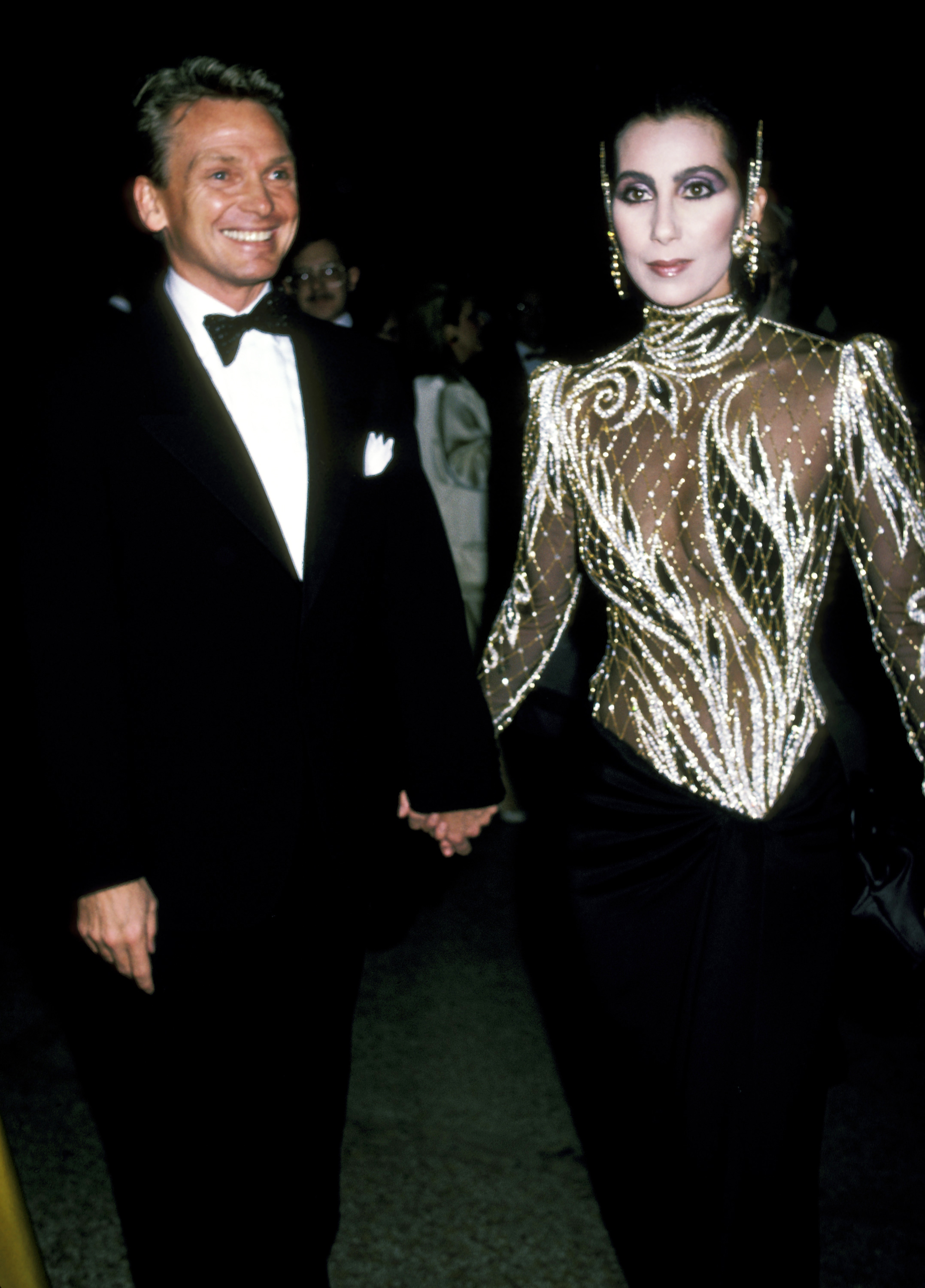 Designer and longtime collaborator Bob Mackie and Cher attend the Metropolitan Museum's Costume Institute Gala in New York City on Dec. 9, 1985.