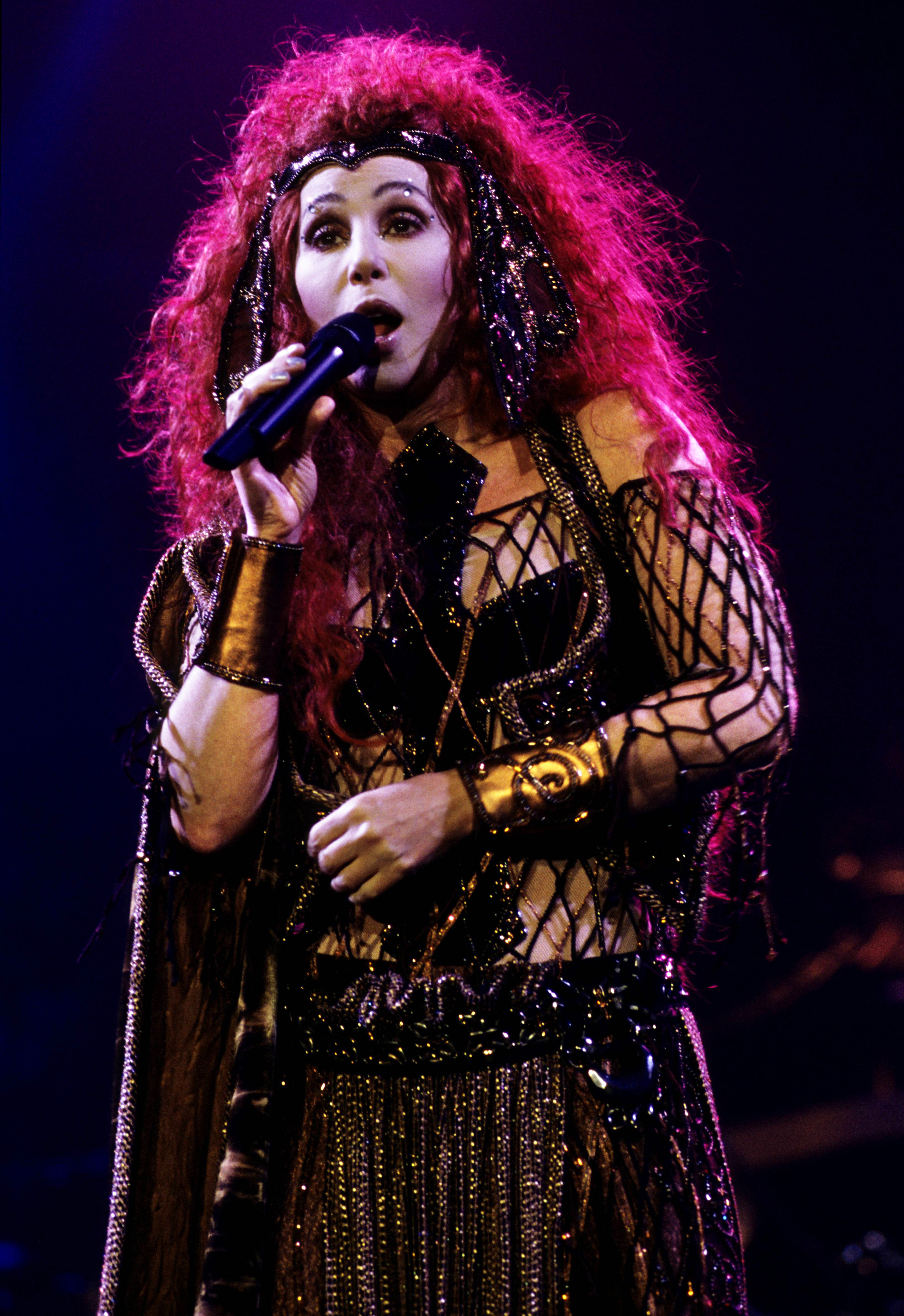 Cher performs during her  Do You Believe?  tour in the U.K. in 1999.