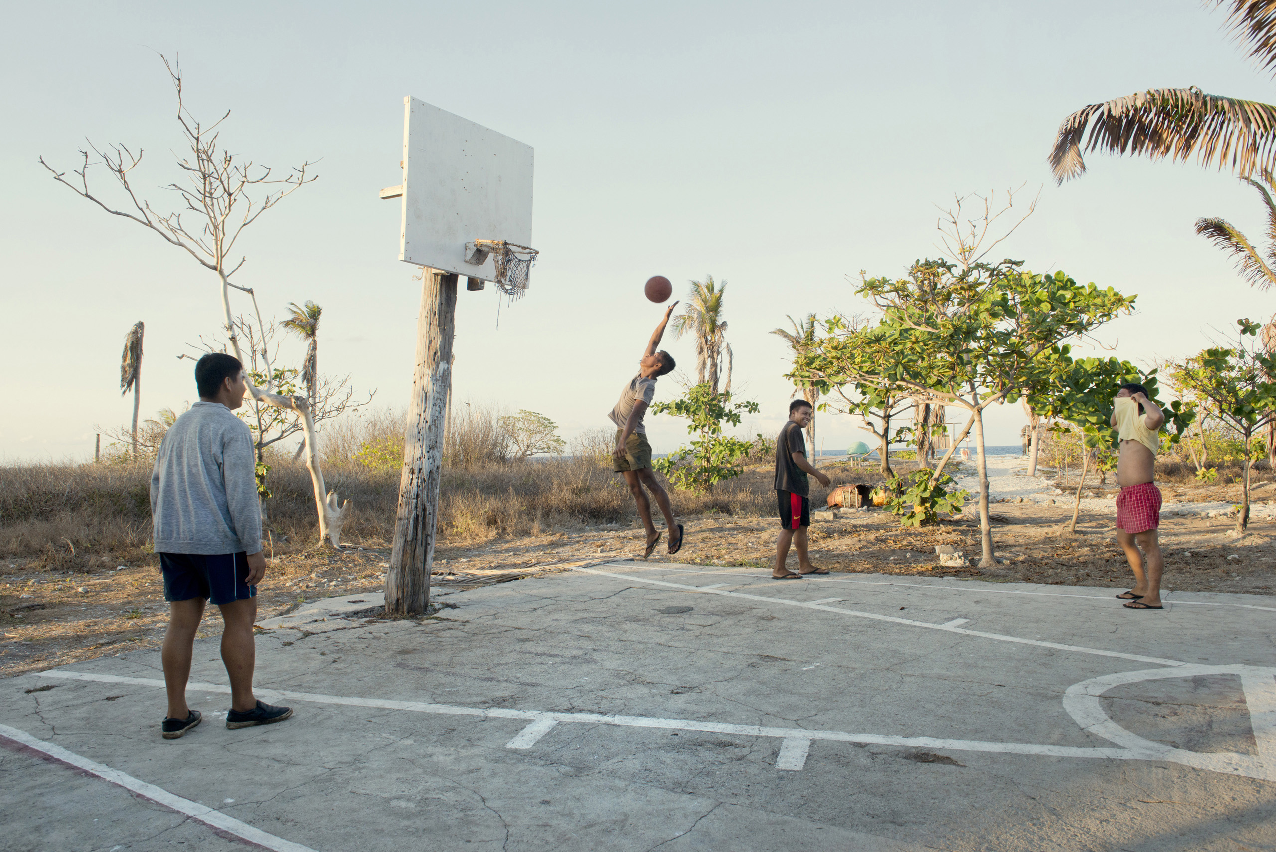 Soldiers play basketball on  Nanshan Island (aka Lawak Island) another of the Spratly Islands, May 8, 2016.