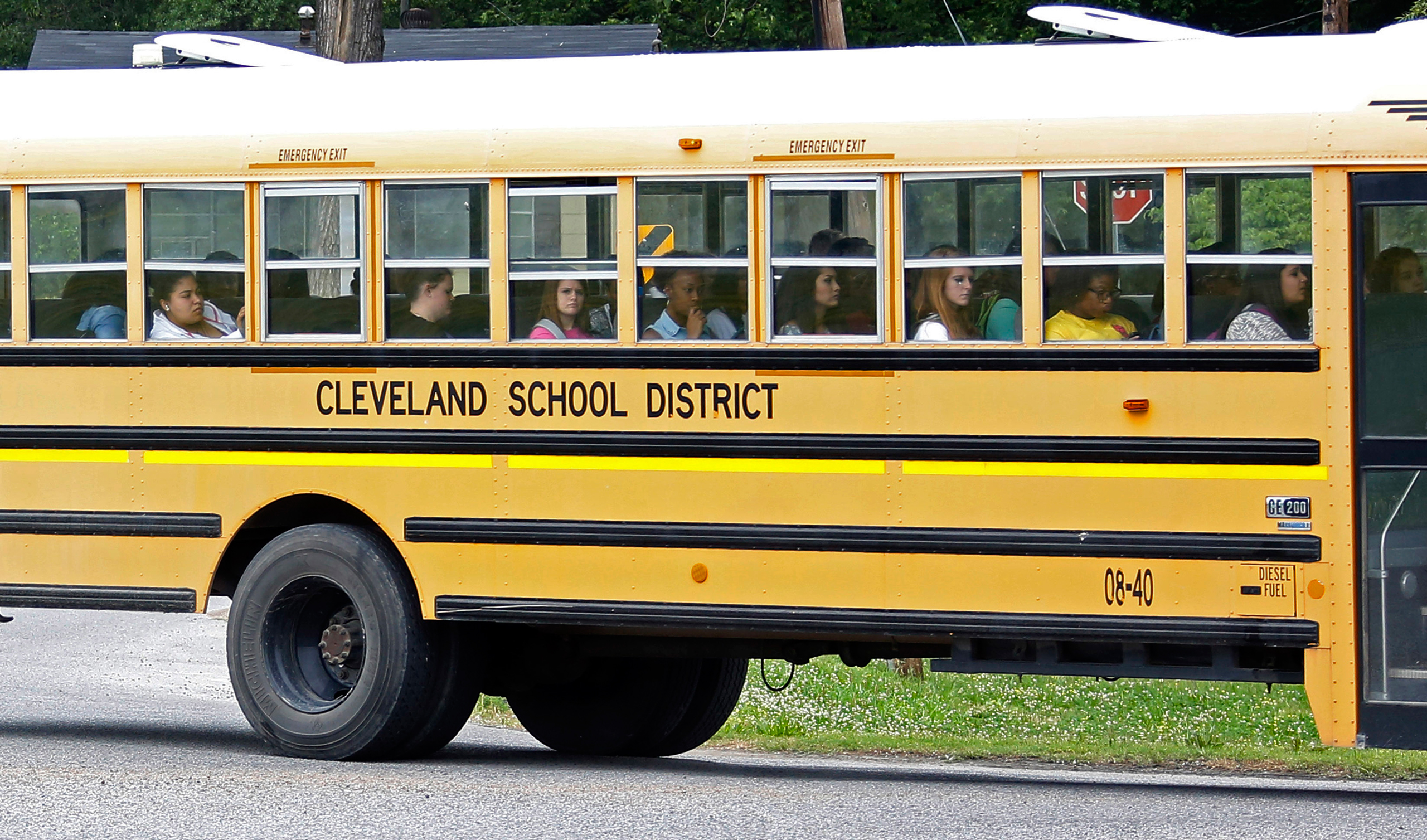 An integrated group of Cleveland, Miss., public school students ride the school district bus on their way home following classes on May 13, 2015.