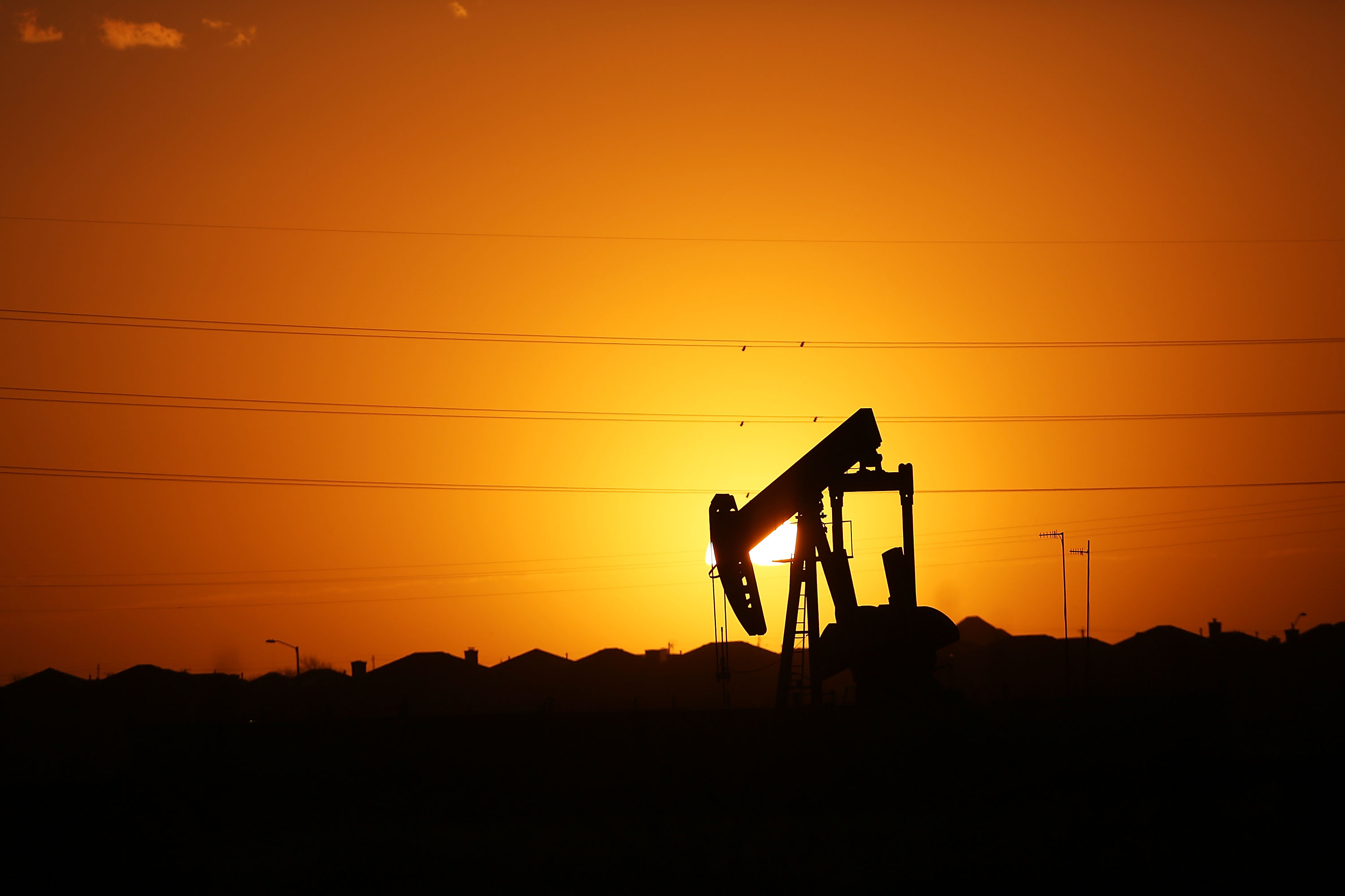 A pumpjack sits on the outskirts of town at dawn in the Permian Basin oil field on Jan. 21, 2016 in the oil town of Midland, Texas.