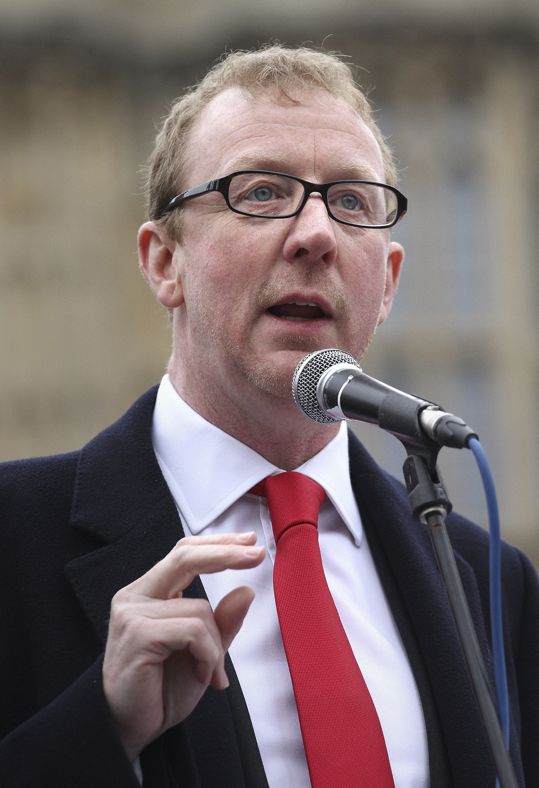 Dave Rowntree, the drummer from the band Blur, speaks outside the Houses of Parliament in London, May 22, 2013.
