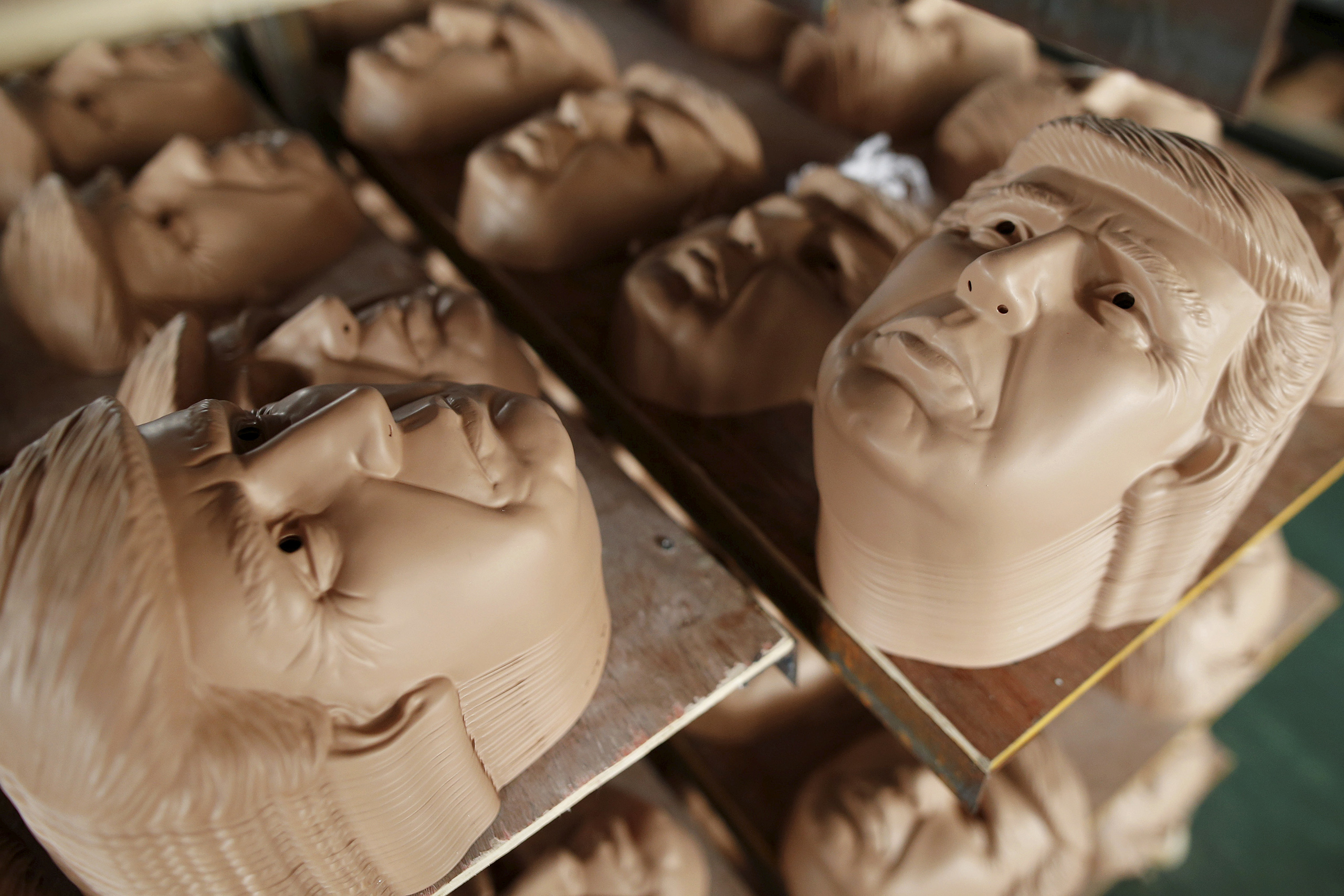 Masks of Republican presidential candidate Donald Trump dry on shelves at Jinhua Partytime Latex Art and Crafts Factory in Jinhua, Zhejiang Province, China, May 25, 2016.