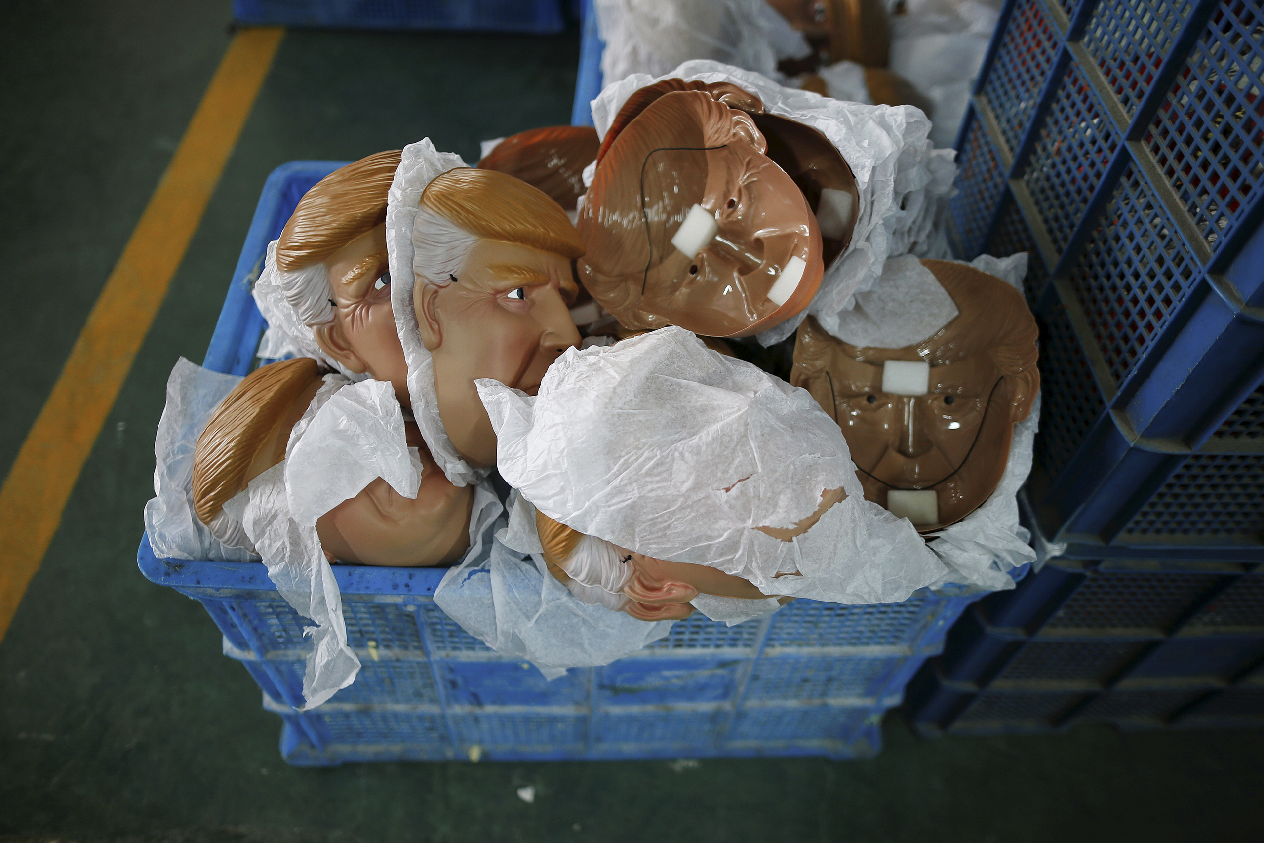 Masks of Republican presidential candidate Donald Trump lie in a box at Jinhua Partytime Latex Art and Crafts Factory in Jinhua, Zhejiang Province, China, May 25, 2016.