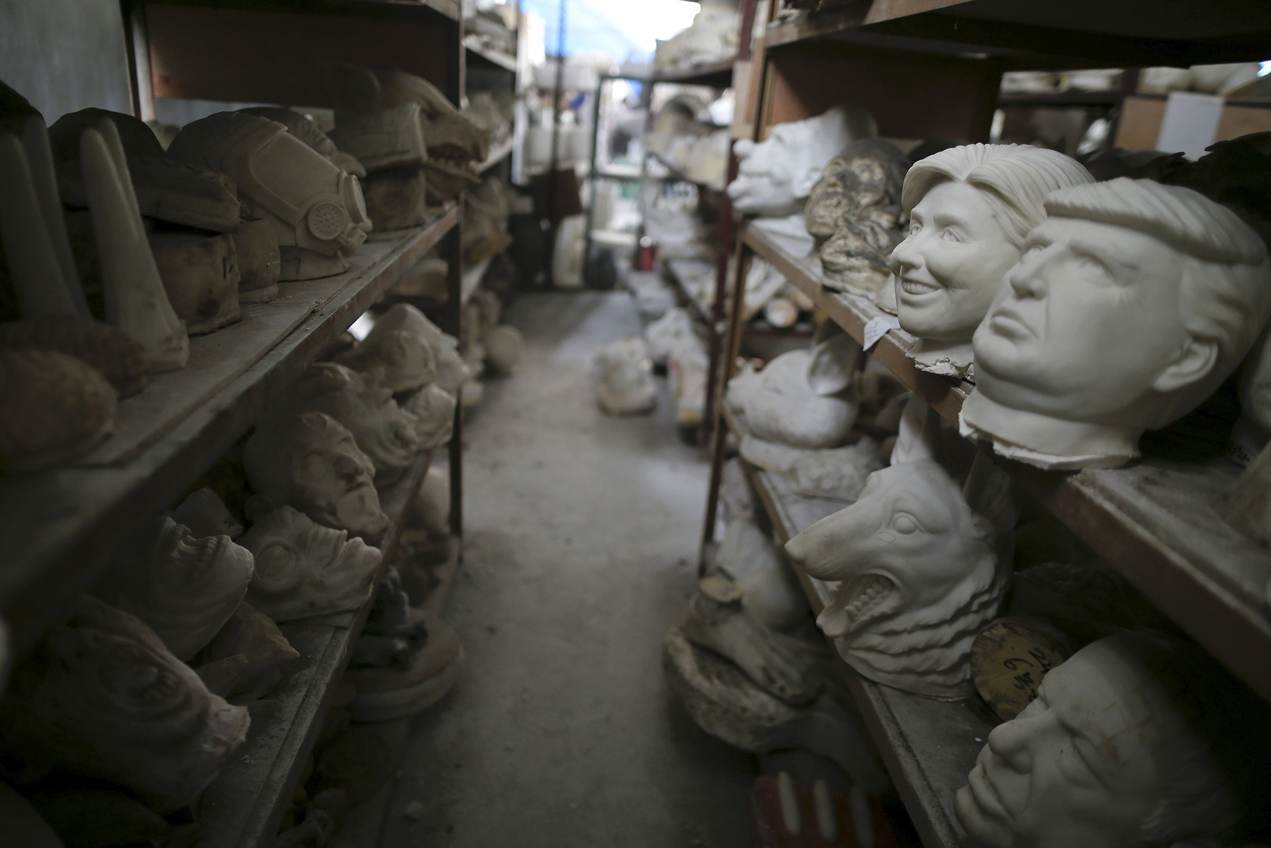 Molds for different masks, including those of Democratic presidential candidate Hillary Clinton and Republican presidential candidate Donald Trump, sit on shelves at Jinhua Partytime Latex Art and Crafts Factory in Jinhua, Zhejiang Province, China, May 25, 2016.