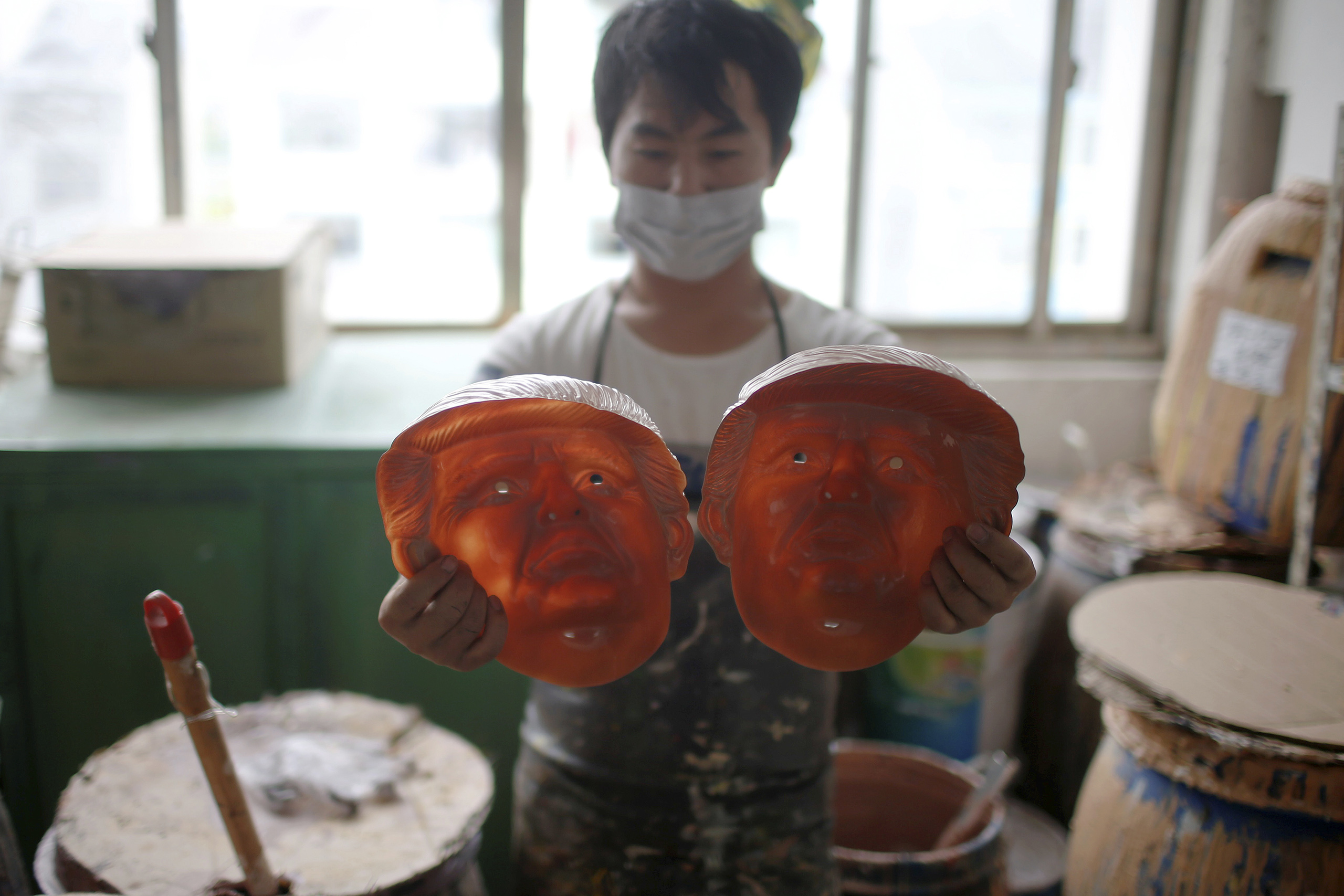 A worker checks masks of Republican presidential candidate Donald Trump at Jinhua Partytime Latex Art and Crafts Factory in Jinhua, Zhejiang Province, China, May 25, 2016.