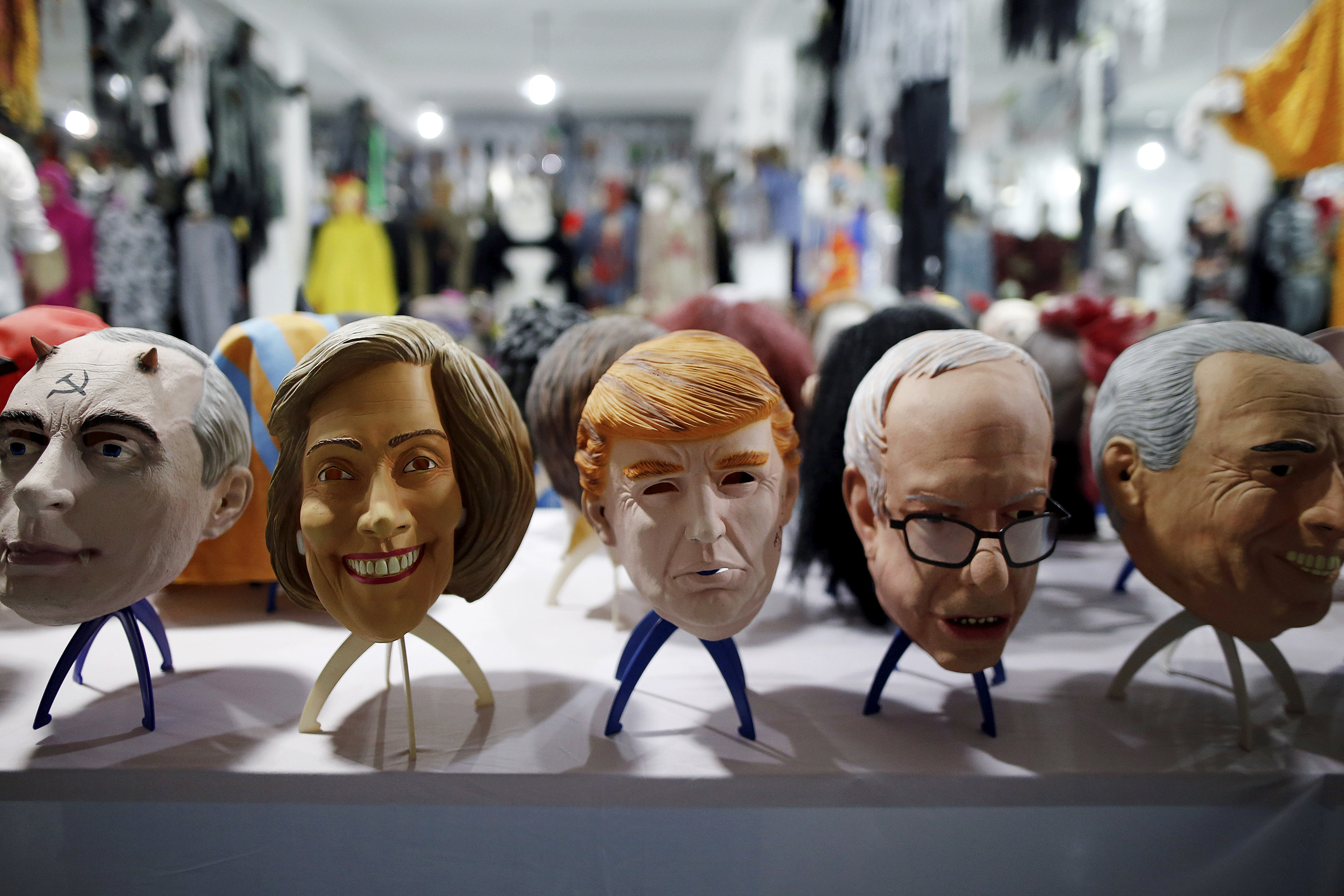 Masks of different politicians are displayed in the showroom of Jinhua Partytime Latex Art and Crafts Factory in Jinhua, Zhejiang Province, China, May 25, 2016.