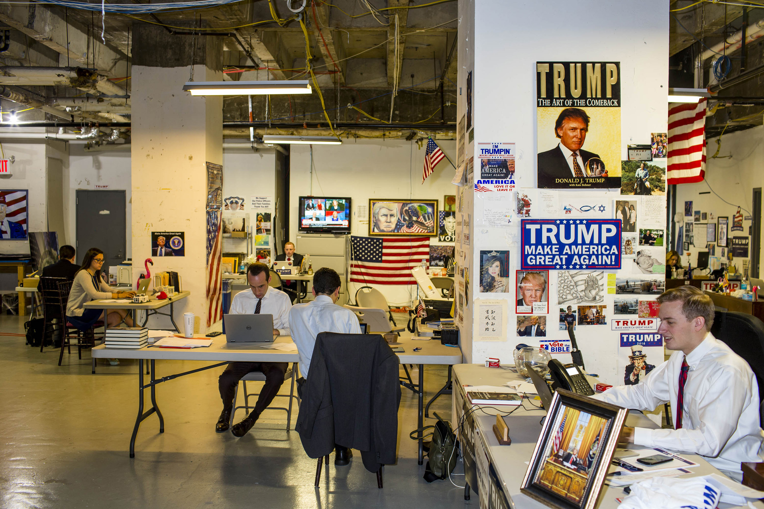Workers inside the campaign headquarters of Donald Trump on May 24, 2016, in New York City. The office is an unfinished space in Trump Tower that was once a production office for The Apprentice, the headquarters is decorated with campaign memorabilia.