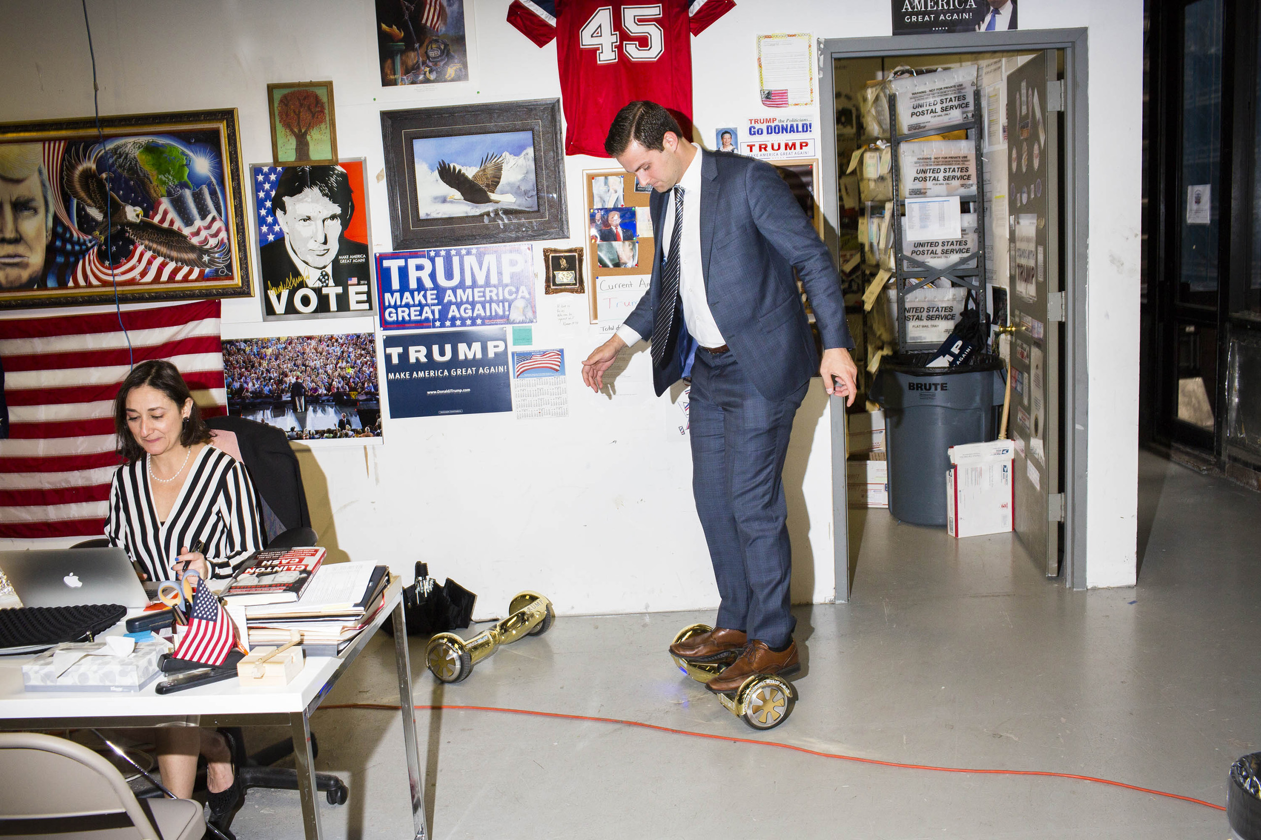 John McEntee, Trump's Campaign Trip Director, rides a hoverboard at the campaign headquarters of Donald Trump in New York City, on May 24, 2016.