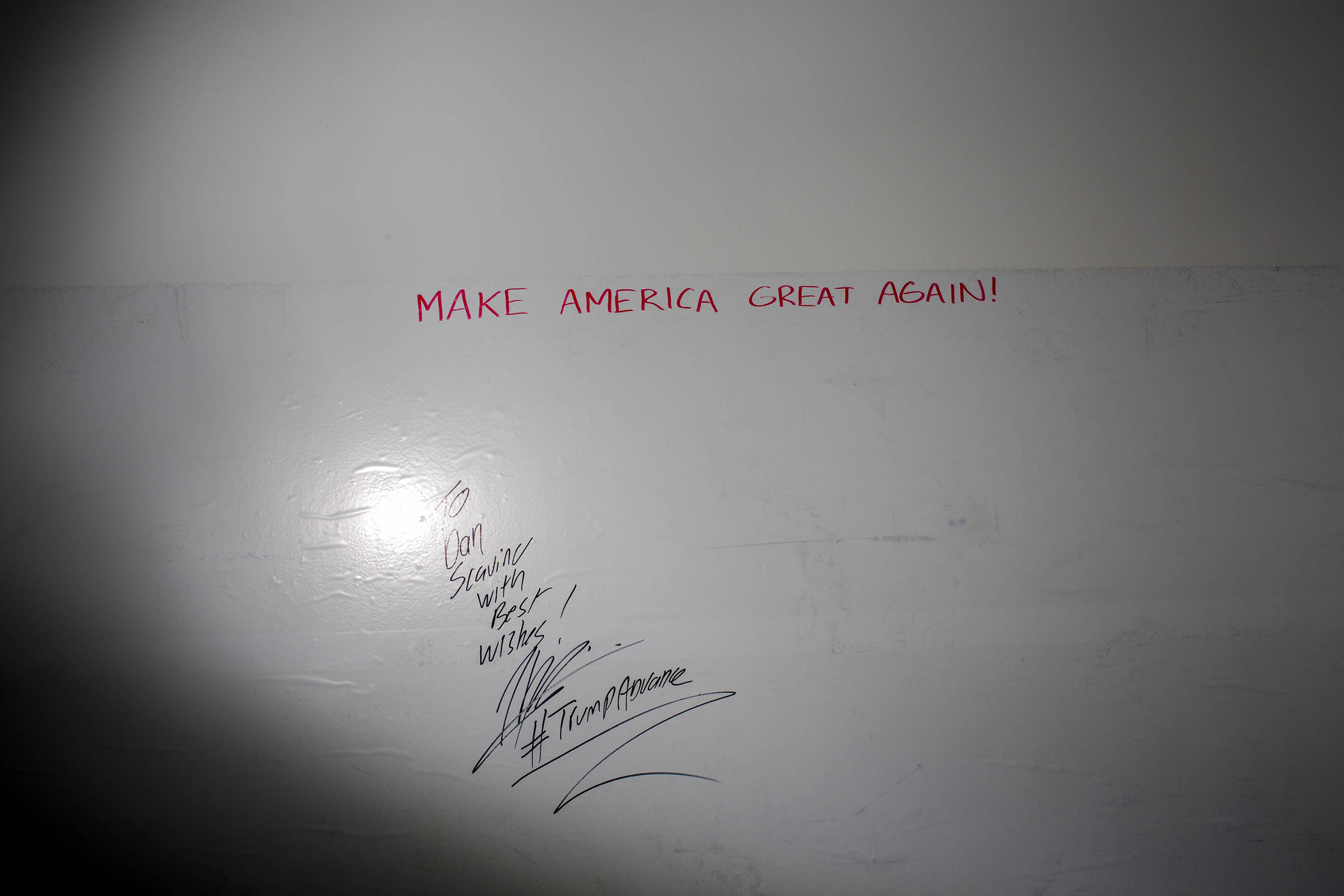 Donald Trumps campaign slogan on a wall inside the campaign headquarters on May 24, 2016, in Trump Tower, New York City.