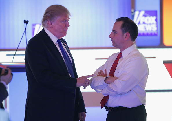Republican presidential candidate Donald Trump (L) speaks with Reince Priebus, chairman of the Republican National Committee, at a debate sponsored by Fox News at the Fox Theatre on March 3, 2016 in Detroit, Michigan.