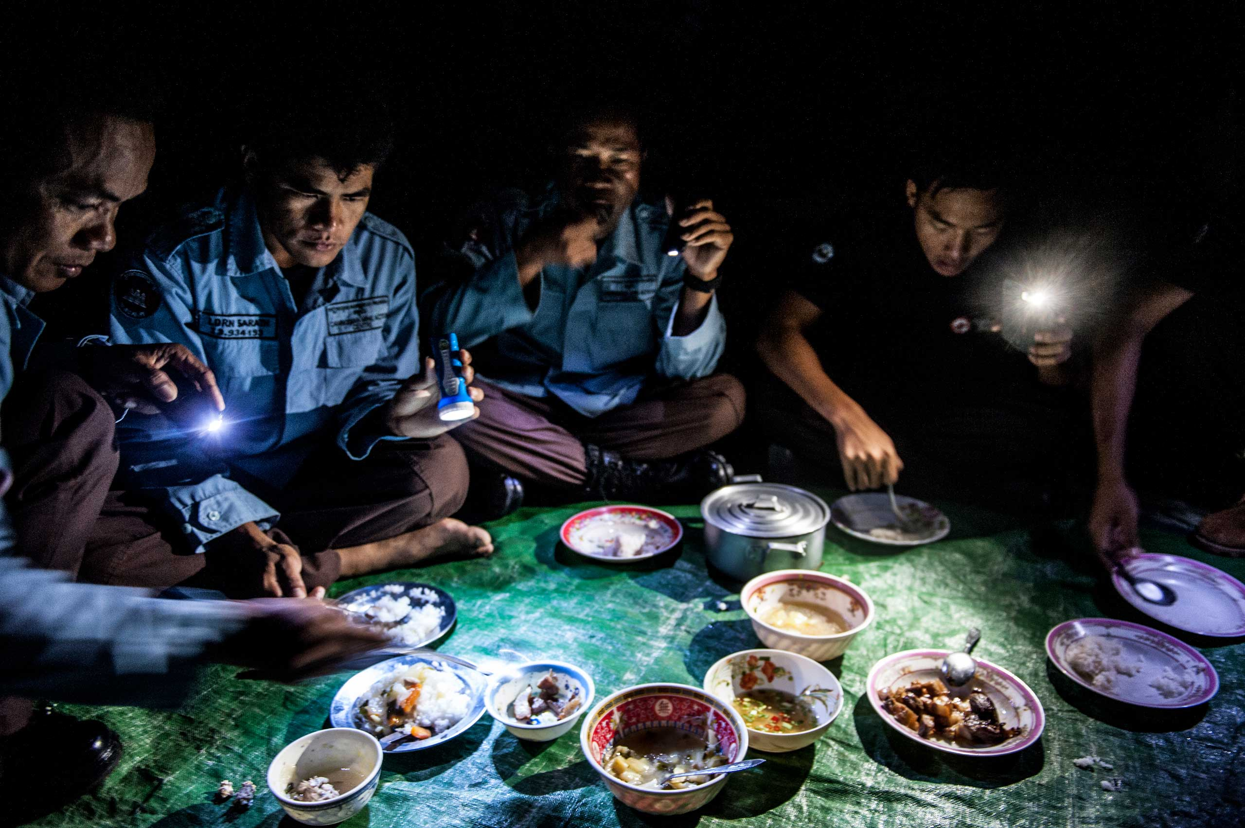 Members of the UXO salvage dive team share breakfast together ahead of a training exercise in March 2014. The divers live together in barracks and eat and cook together, every aspect of their daily life is aimed at creating a tight and cohesive team.
