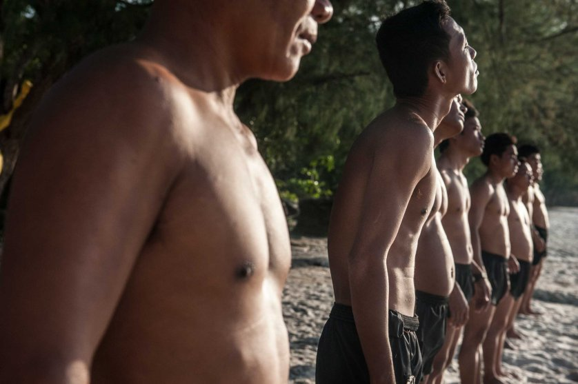 The UXO salvage diver team lines up ahead of a sea swim for training on the island of Koh Rong off the coast of Sihanoukville, Cambodia in April 2013. The divers were previously de-miners with the Cambodian Mine Action Centre and were selected by the Golden West Humanitarian Foundation from a group of over 40 applicants.