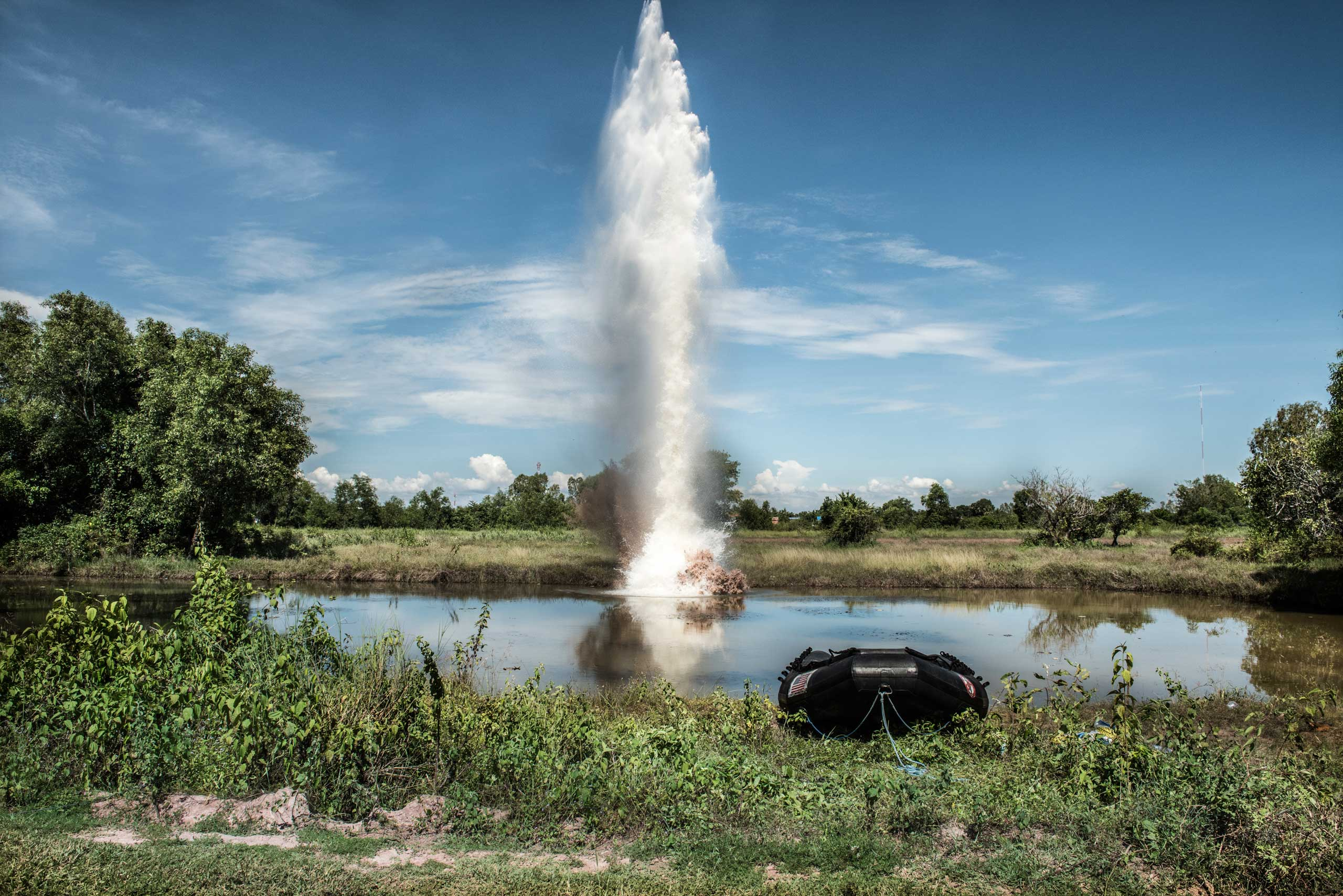 A plume of water shoots into the sky after liquid explosives are detonated underwater. The explosives were tested to see if they would be a viable solution to detonate UXO underwater. The test took place at the divers' training centre in Kampong Chhanang Province, Cambodia in Feb. 2014