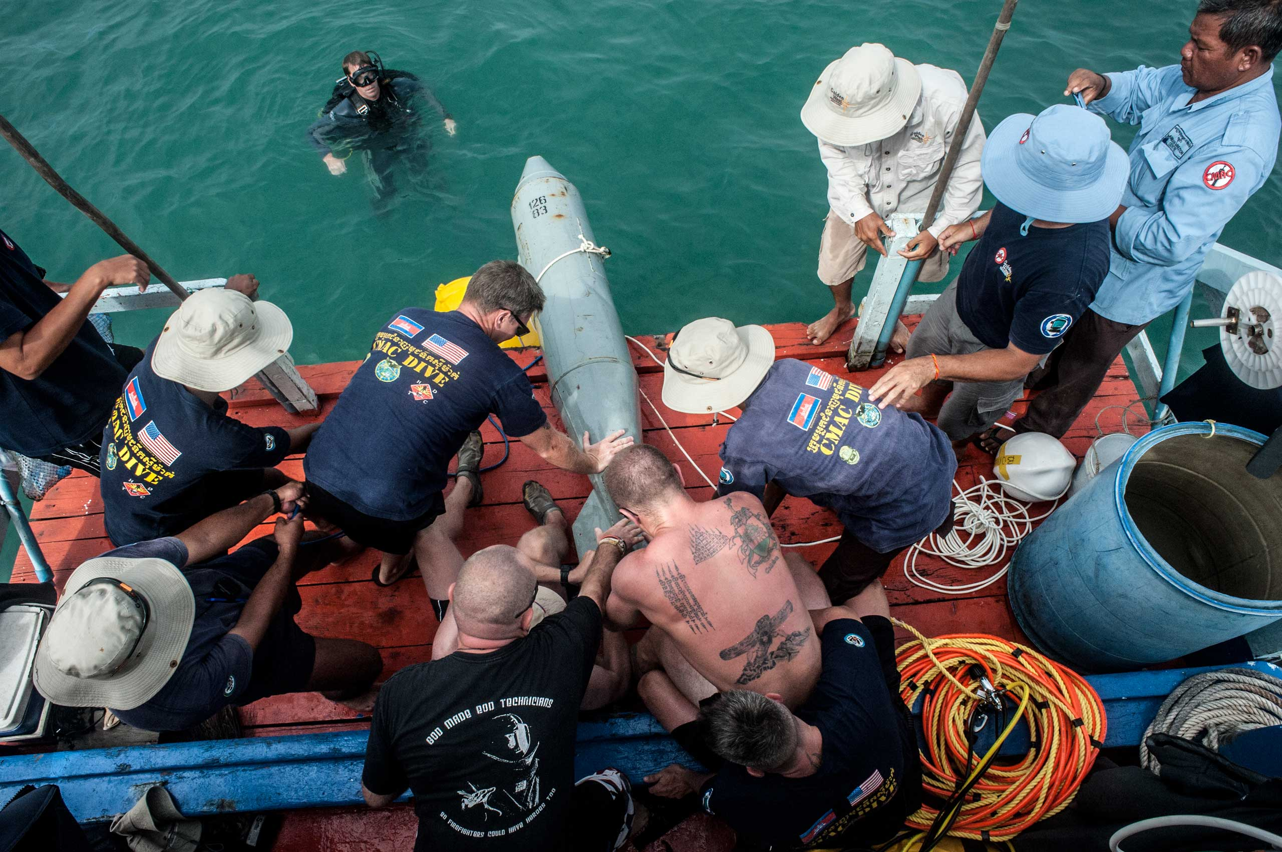 UXO salvage divers and members of the USA 7th Engineer Dive Detachment take part in the training program off the coast of Sihanoukville, Cambodia in July 2014. In this exercise the team was learning how to recover large inert ordinance using airbags to raise the item from the sea bed.