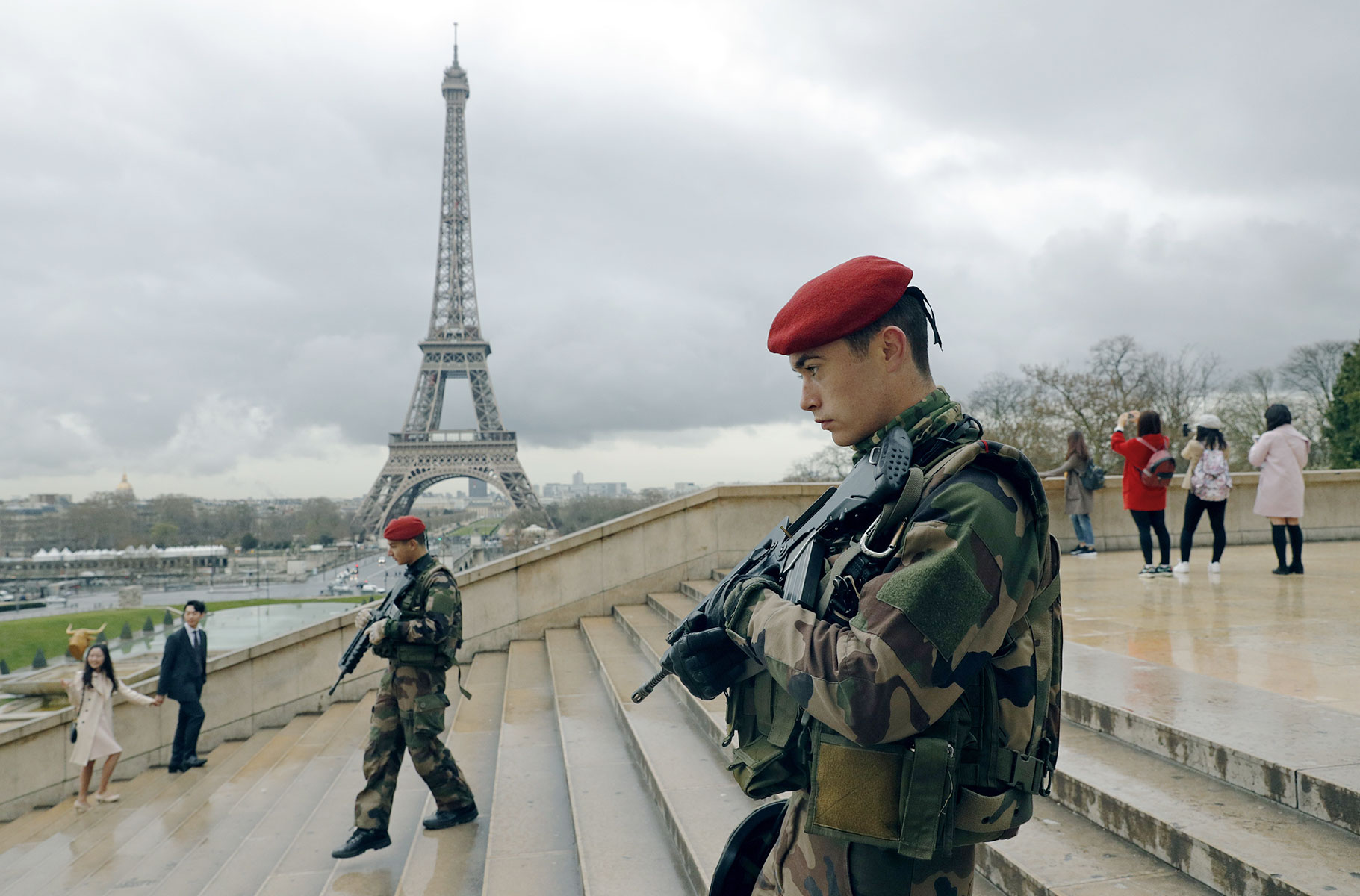 French paratroopers patrol near the Eiffel Tower on March 30 as part of a major security surge