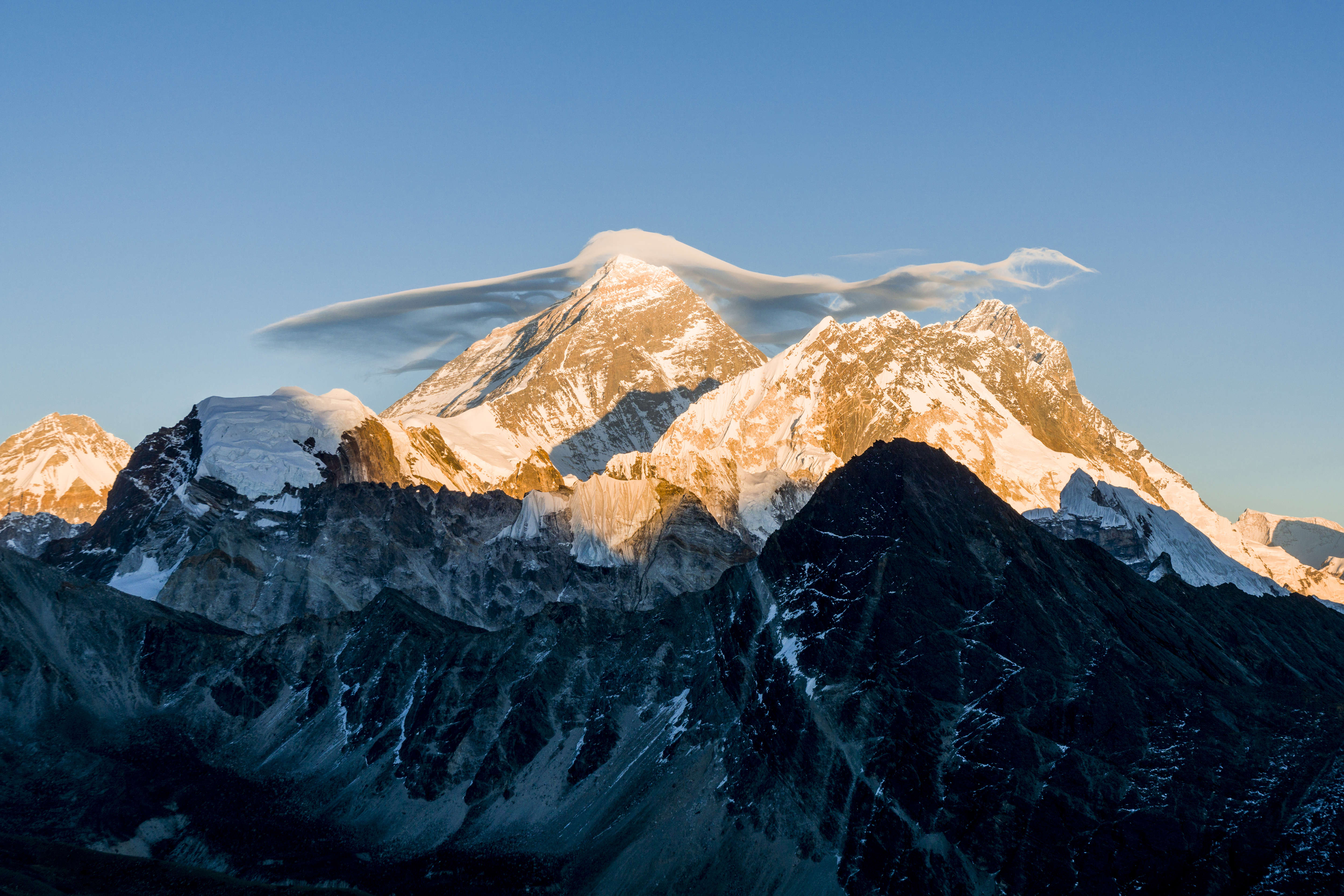 The mountain Mt. Everest (8848m) with a white cloud on top, seen from Gokyo Ri (5360m) at sunset.