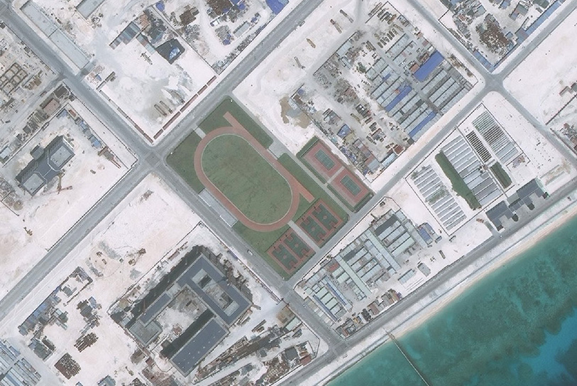 A satellite image of Fiery Cross Reef captured on May 1, 2016, shows a running track, four basketball courts and two tennis courts.