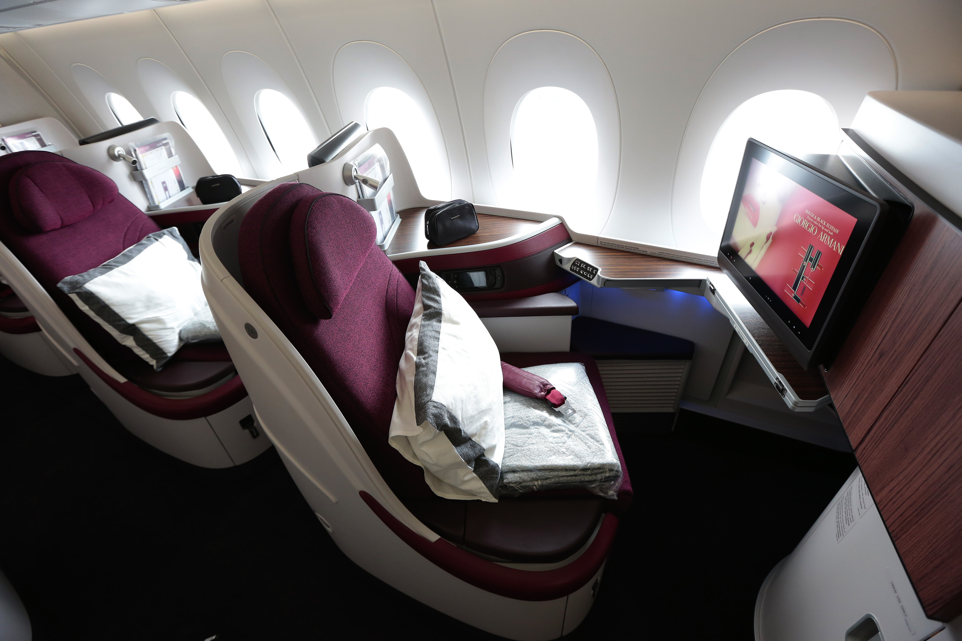 First class cabin booths sit aboard an Airbus SAS A380 aircraft, operated by Qatar Airways Ltd., on the opening day of the 51st International Paris Air Show in Paris, France, on Monday, June 15, 2015.