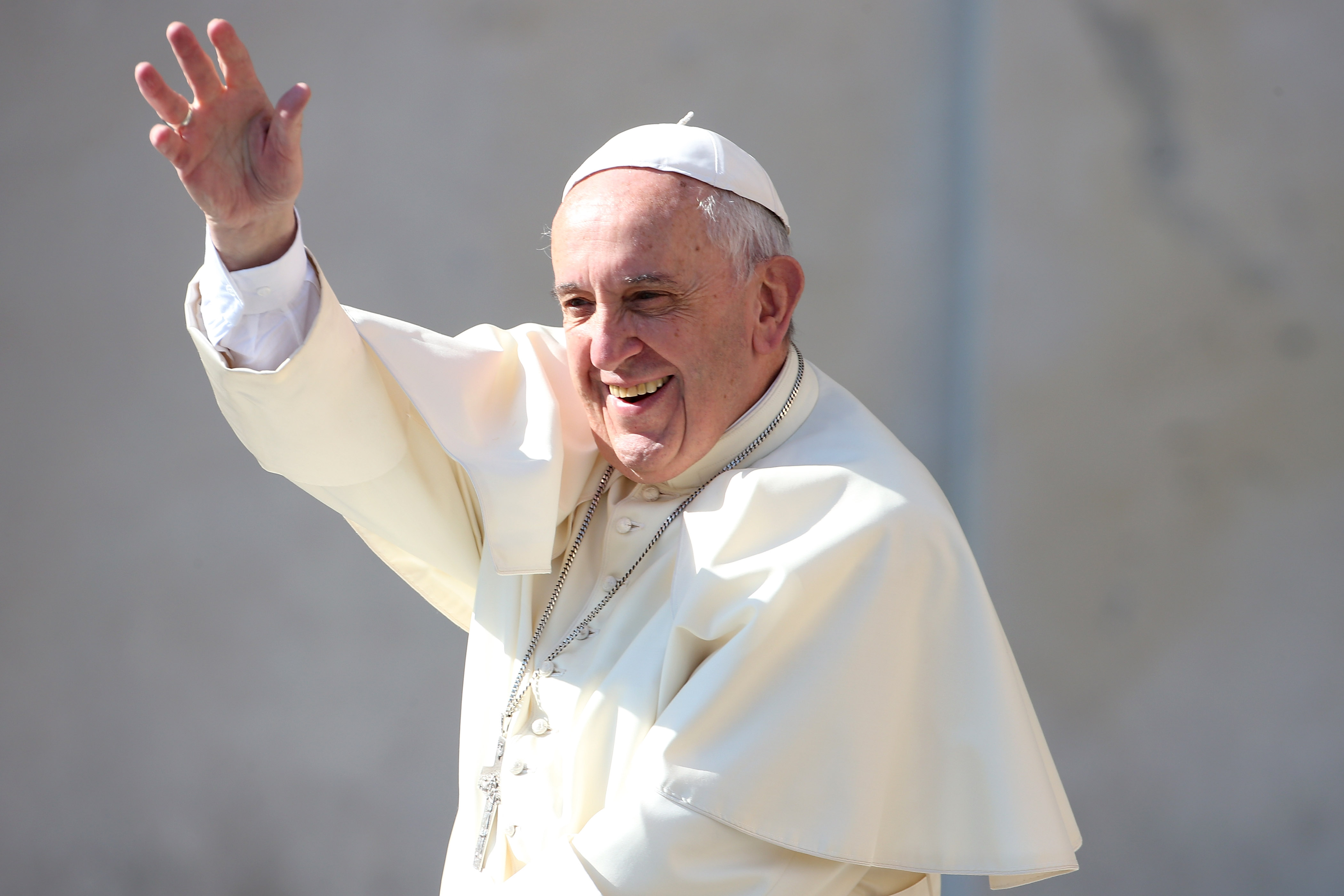 Pope Francis waves to the faithful as he arrives in St. Peter's Square for his weekly audience in Vatican City on May 4, 2016.
