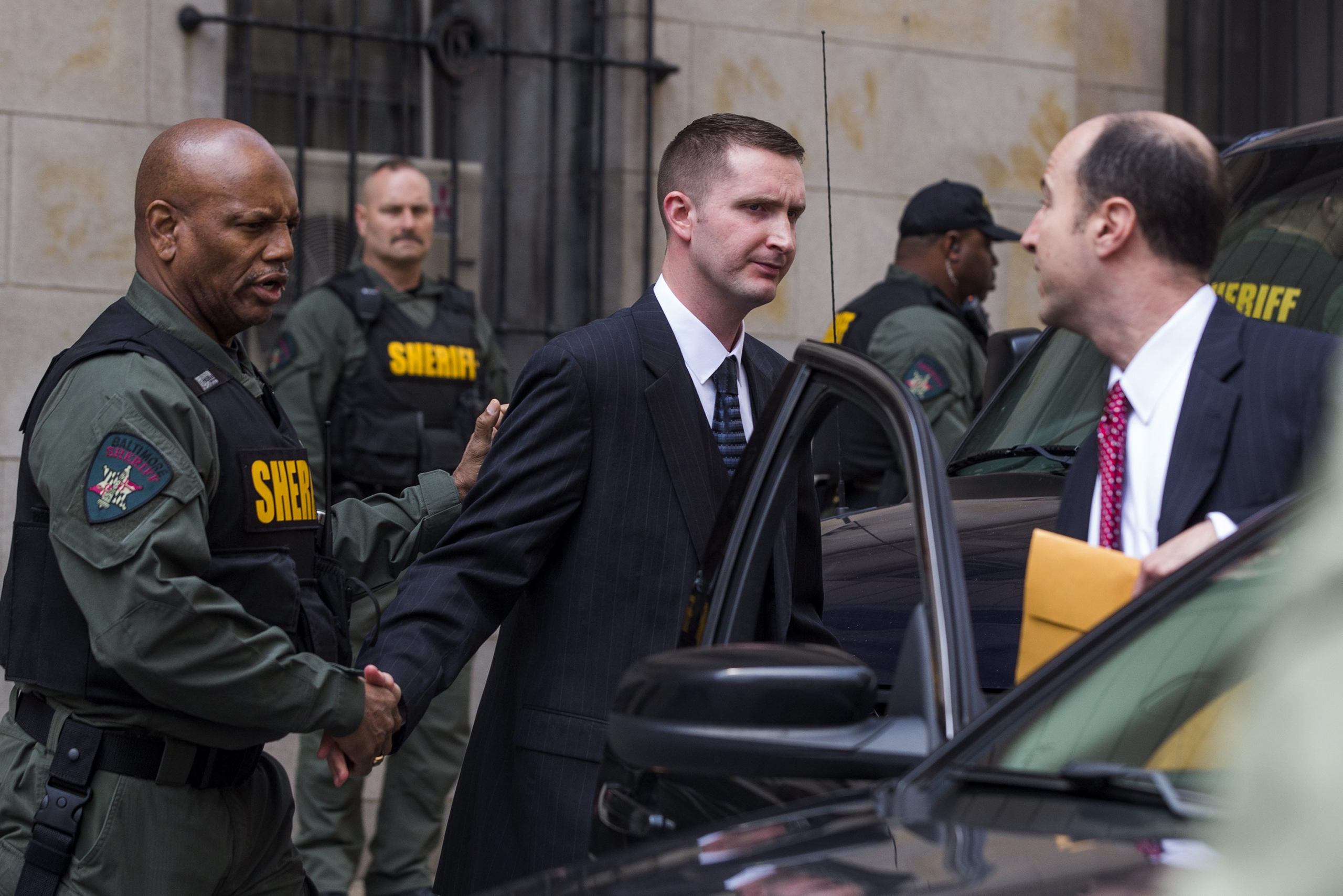 Baltimore police officer Edward Nero, along with his attorney Marc Zayon, leaves the courthouse after being acquitted of all charges in the death of Freddie Gray in Baltimore, MD, May 23, 2016.