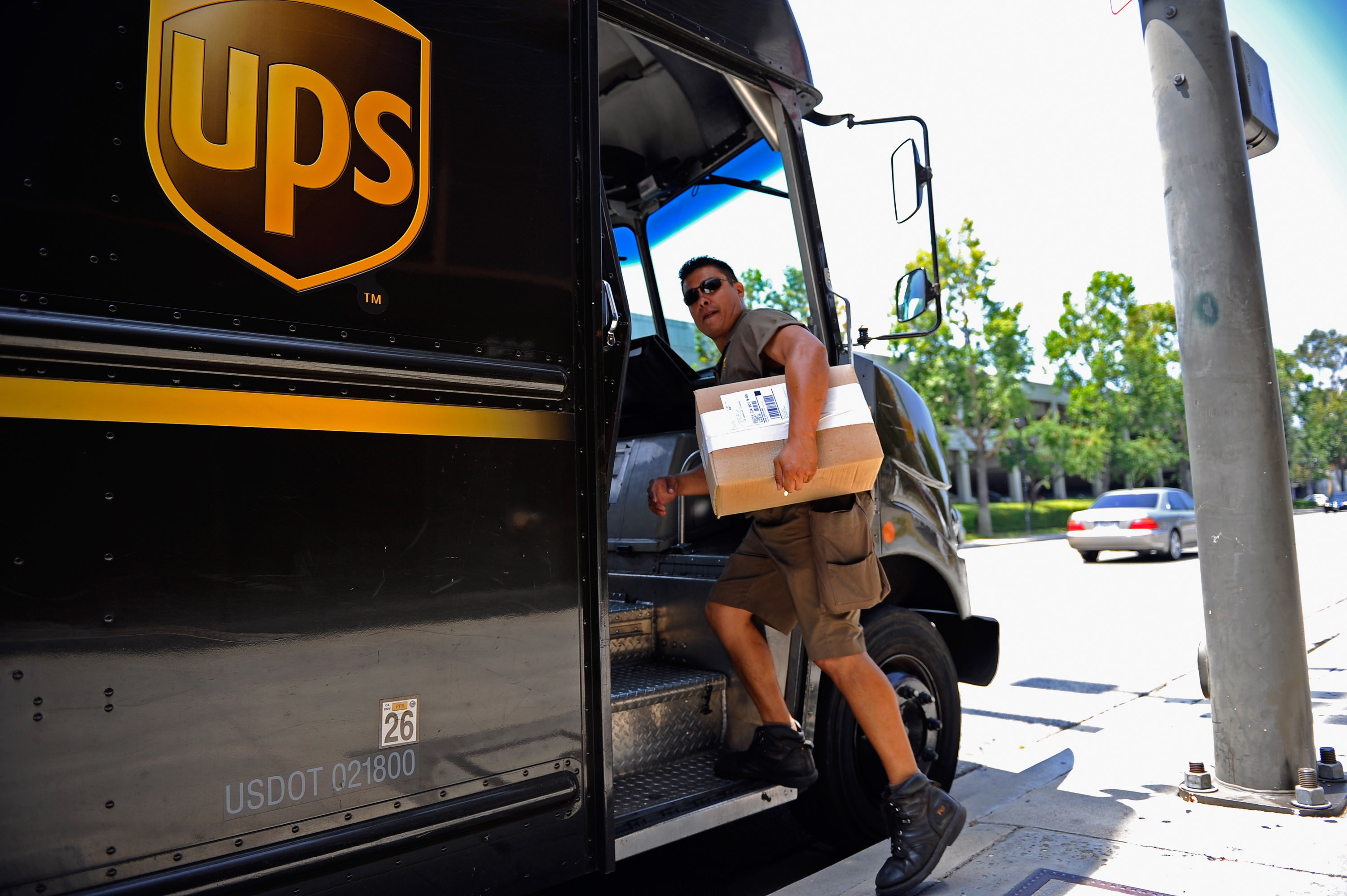 A United Parcel Service (UPS) driver delivers packages on July 22, 2010 in Glendale, California.