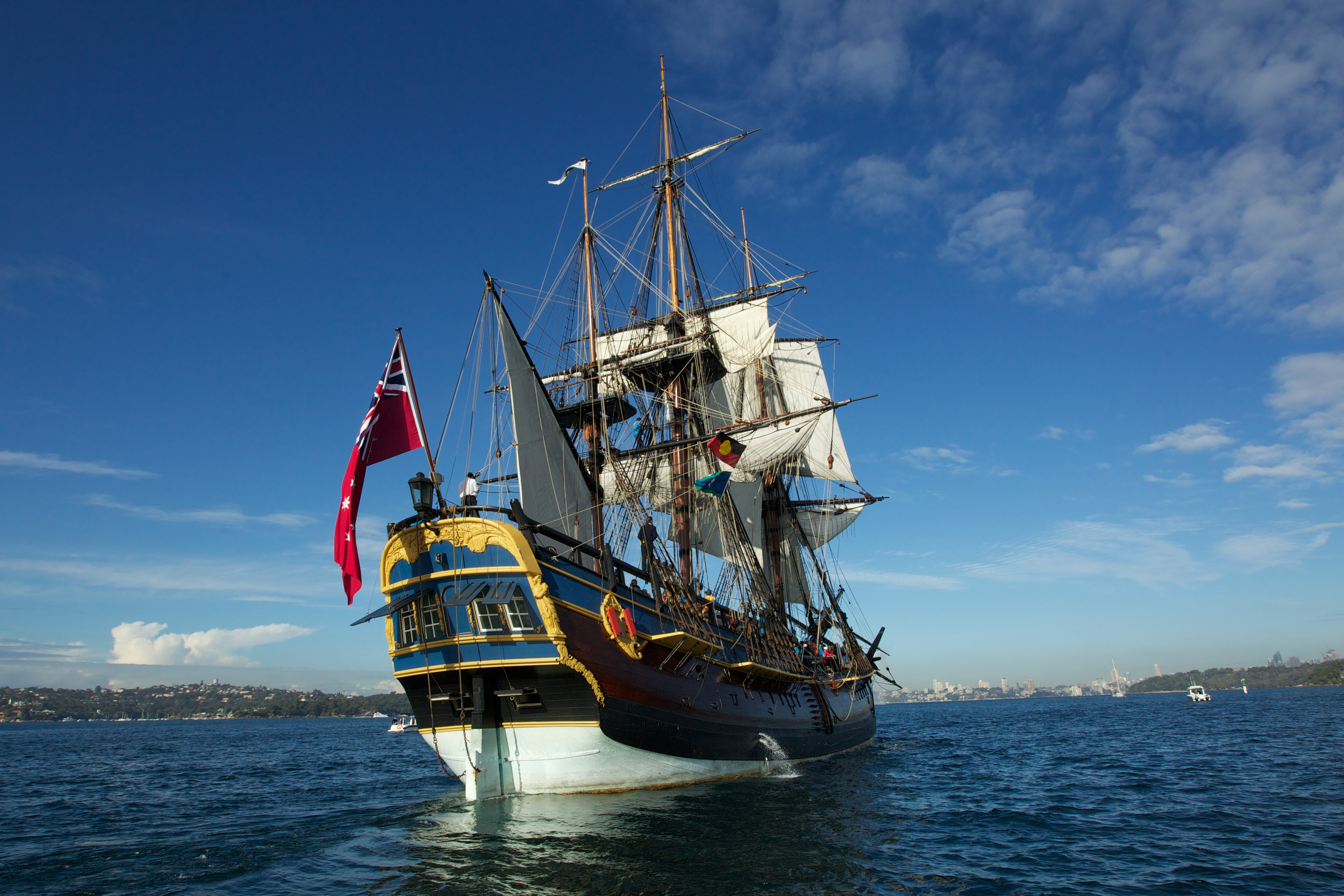 The replica of Captain Cook's ship HMS Endeavour arrives in Sydney Harbor on May 23, 2012, in Sydney