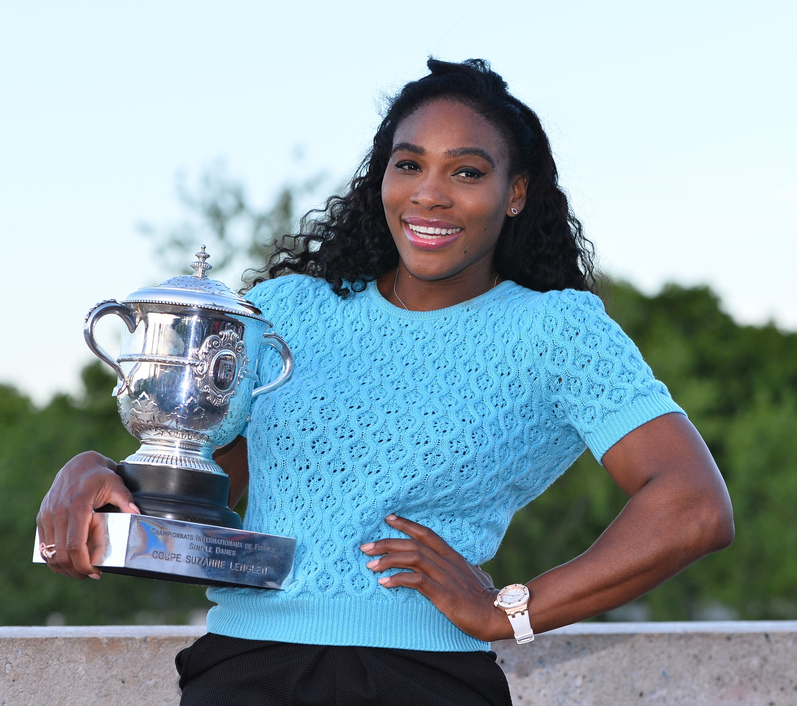Serena Williams poses with the winner's trophy at the Bir-Hakeim bridge after winning the women's final of the French Open tennis championships at Roland Garros in Paris, France on June 6, 2015.