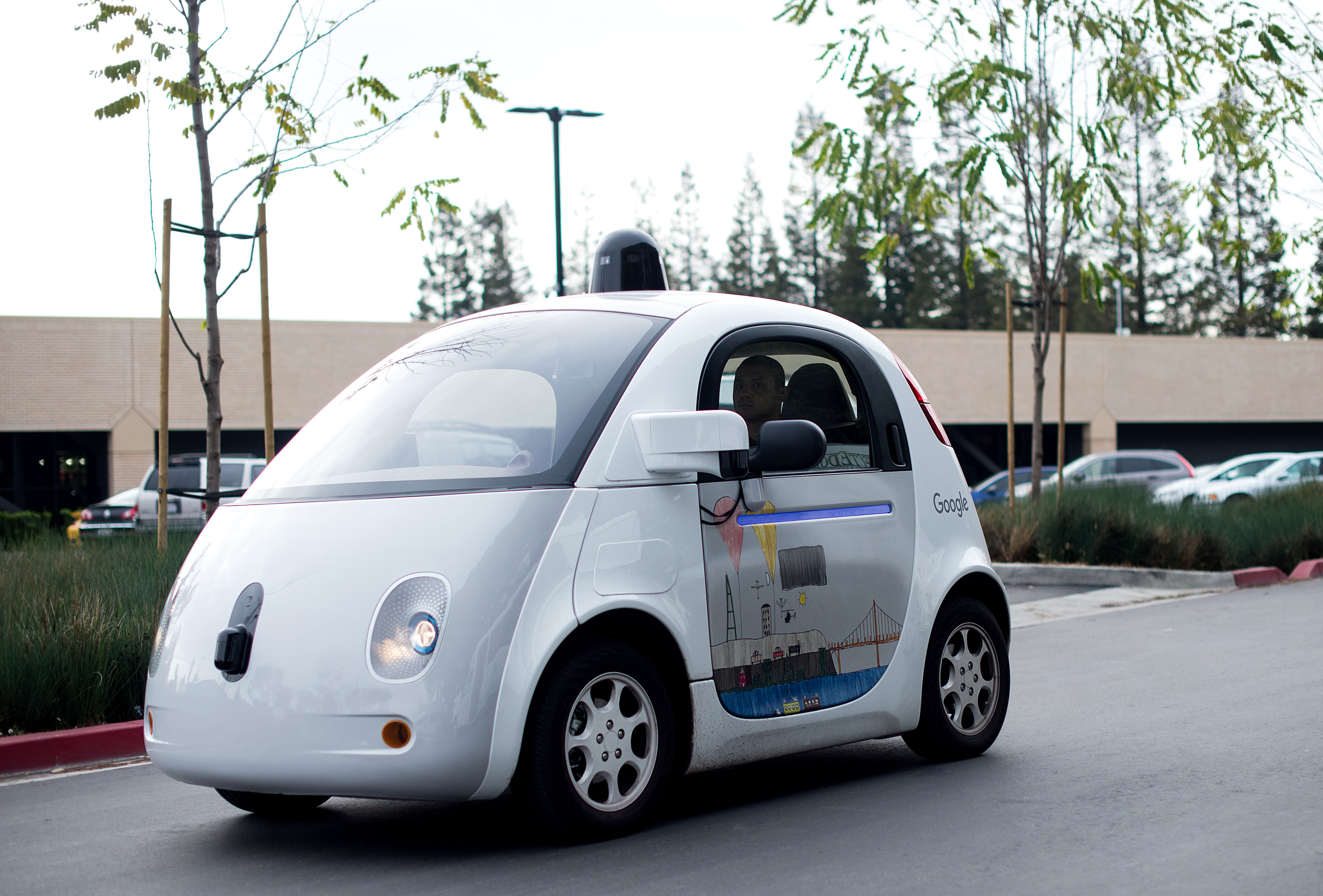 A self-driving car traverses a parking lot at Google's headquarters in Mountain View, California on January 8, 2016.