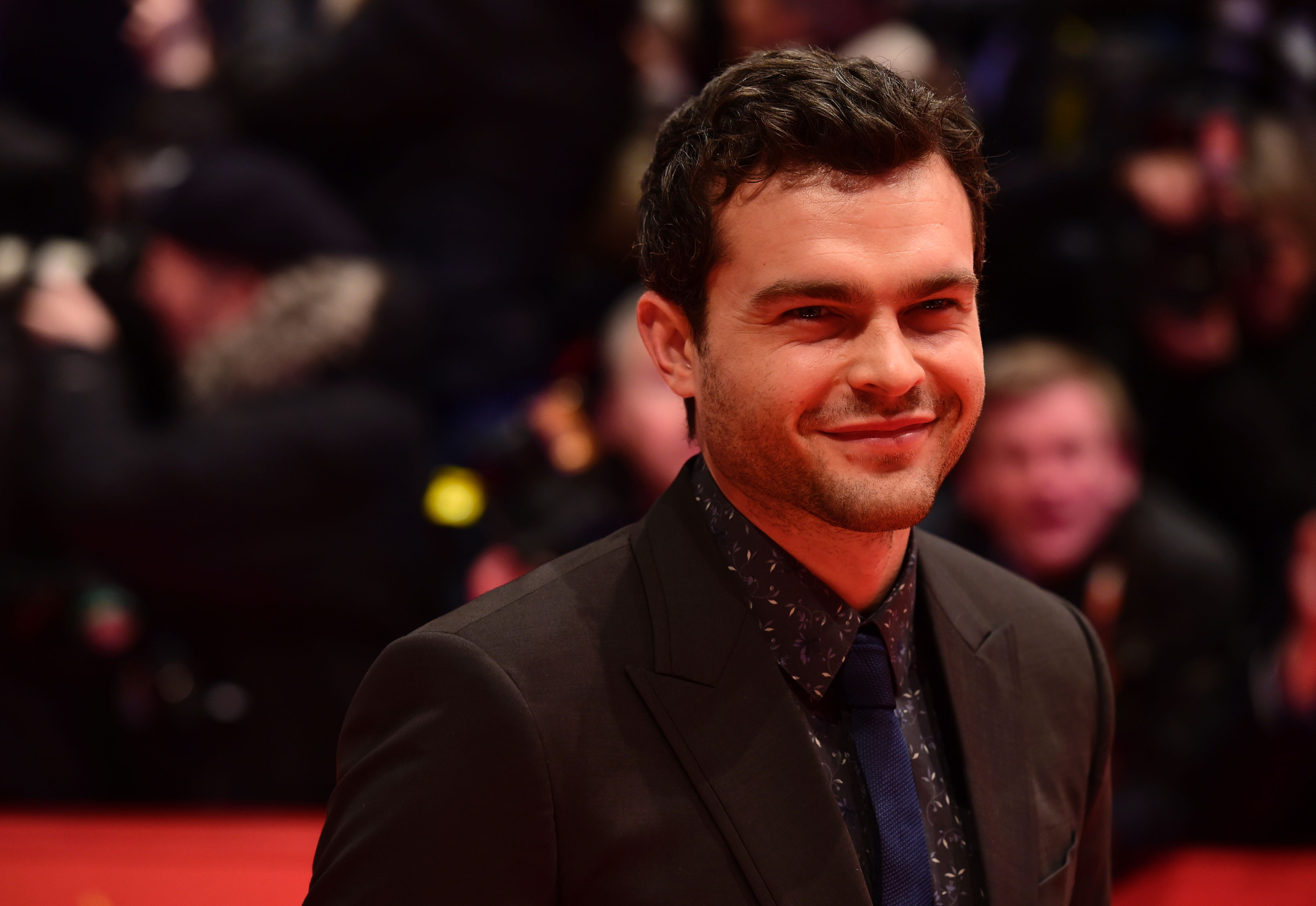 Alden Ehrenreich poses for photographers as he arrives on the red carpet for the film  Hail, Caesar!  screening in Berlin, Feb.11, 2016