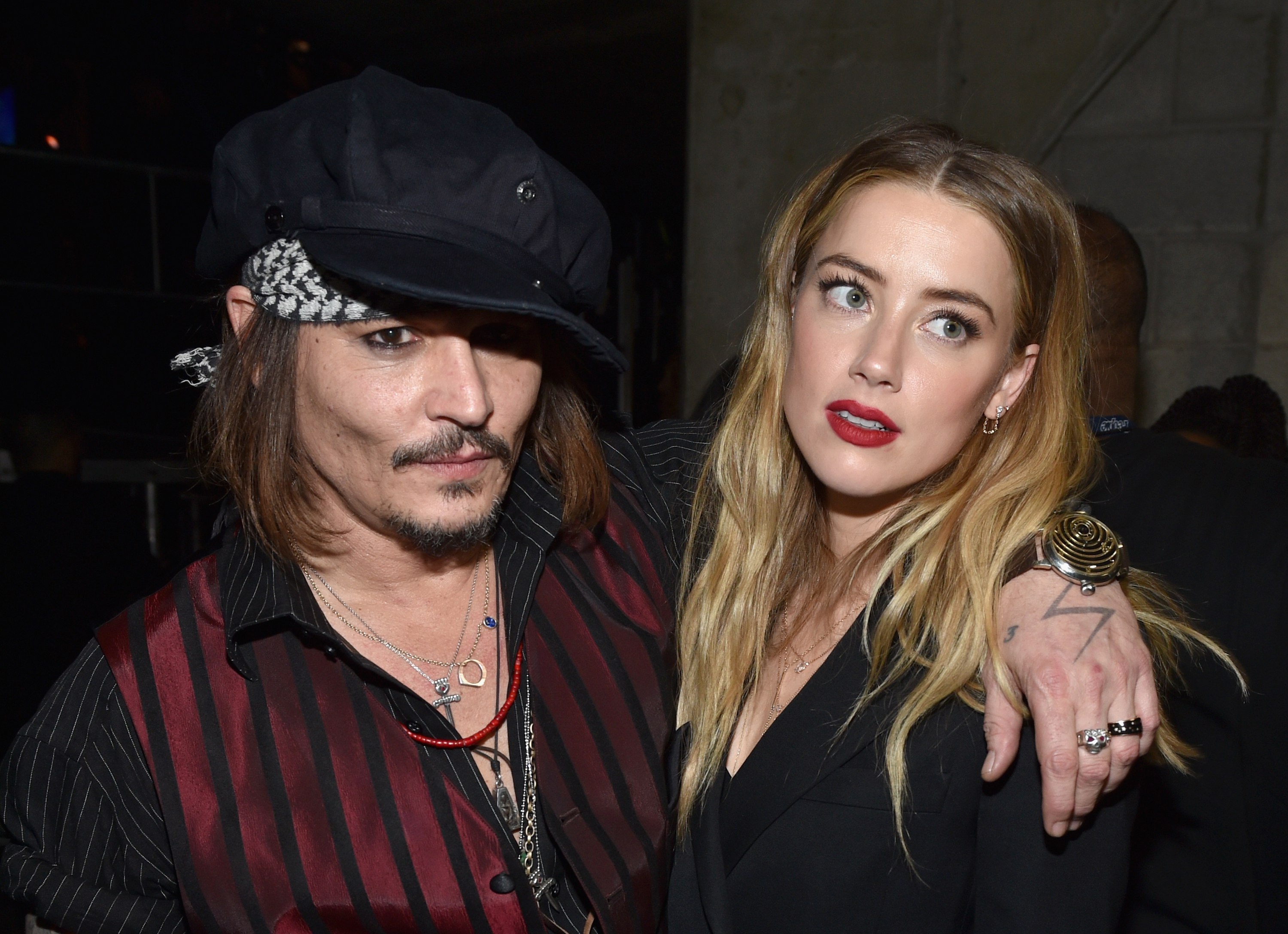 Actor/musician Johnny Depp (L) and actress Amber Heard attend The 58th GRAMMY Awards at Staples Center on February 15, 2016 in Los Angeles, California.  (John Shearer--WireImage)