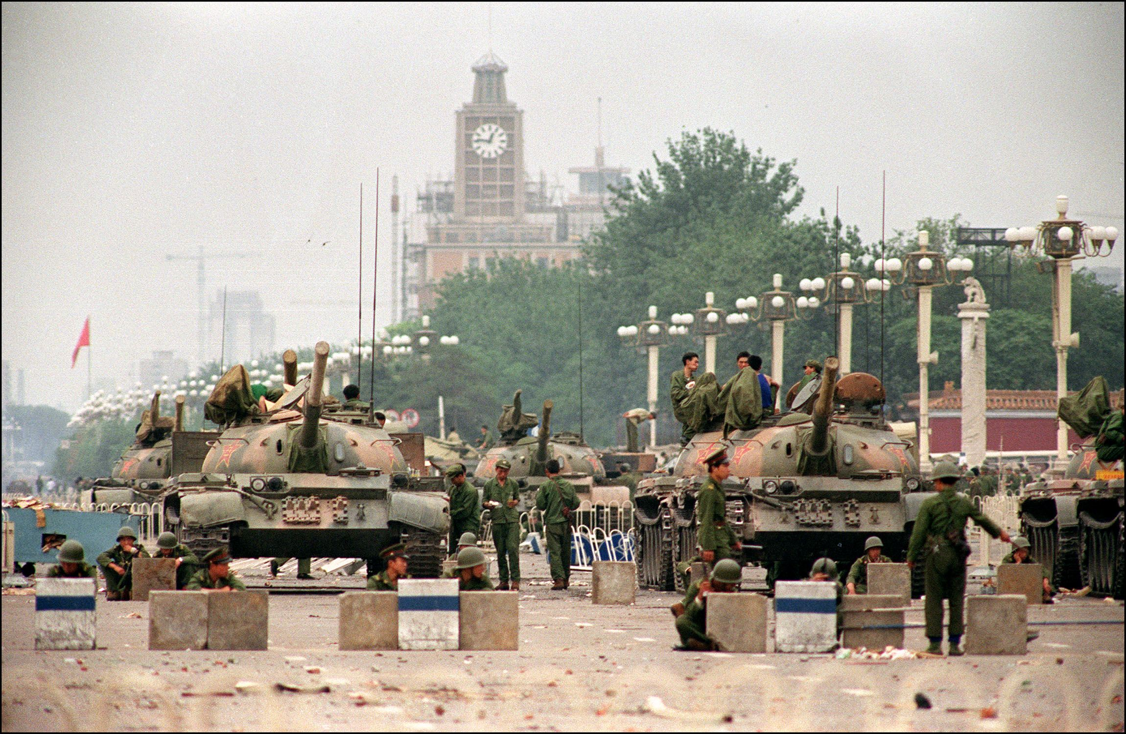 The People's Liberation Army  (PLA) tanks guard a strategic Chang'an Avenue leading to Tiananmen Square June 6 1989.