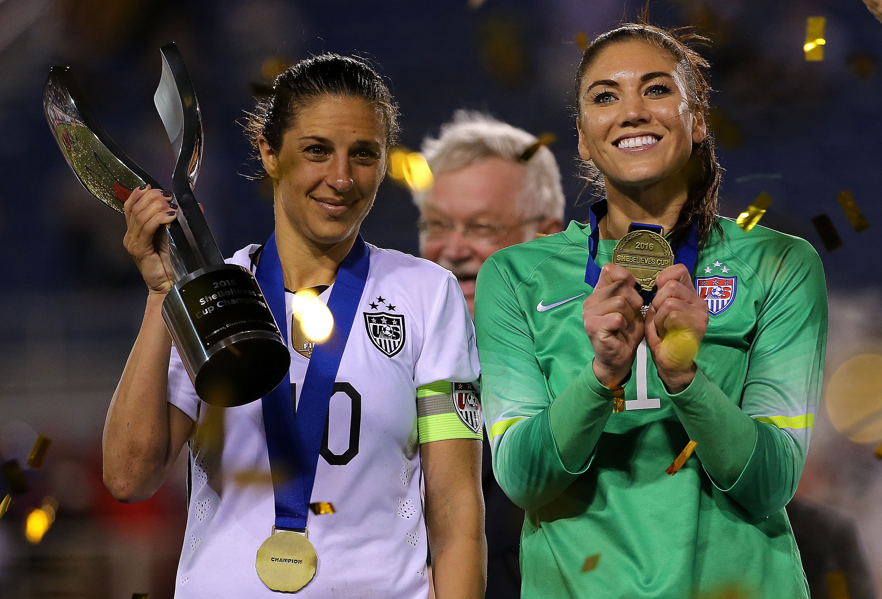 Hope Solo #1 and Carli Lloyd #10 of the United States celebrate after winning a match against Germany in the 2016 SheBelieves Cup on March 9, 2016 in Boca Raton, Fla.