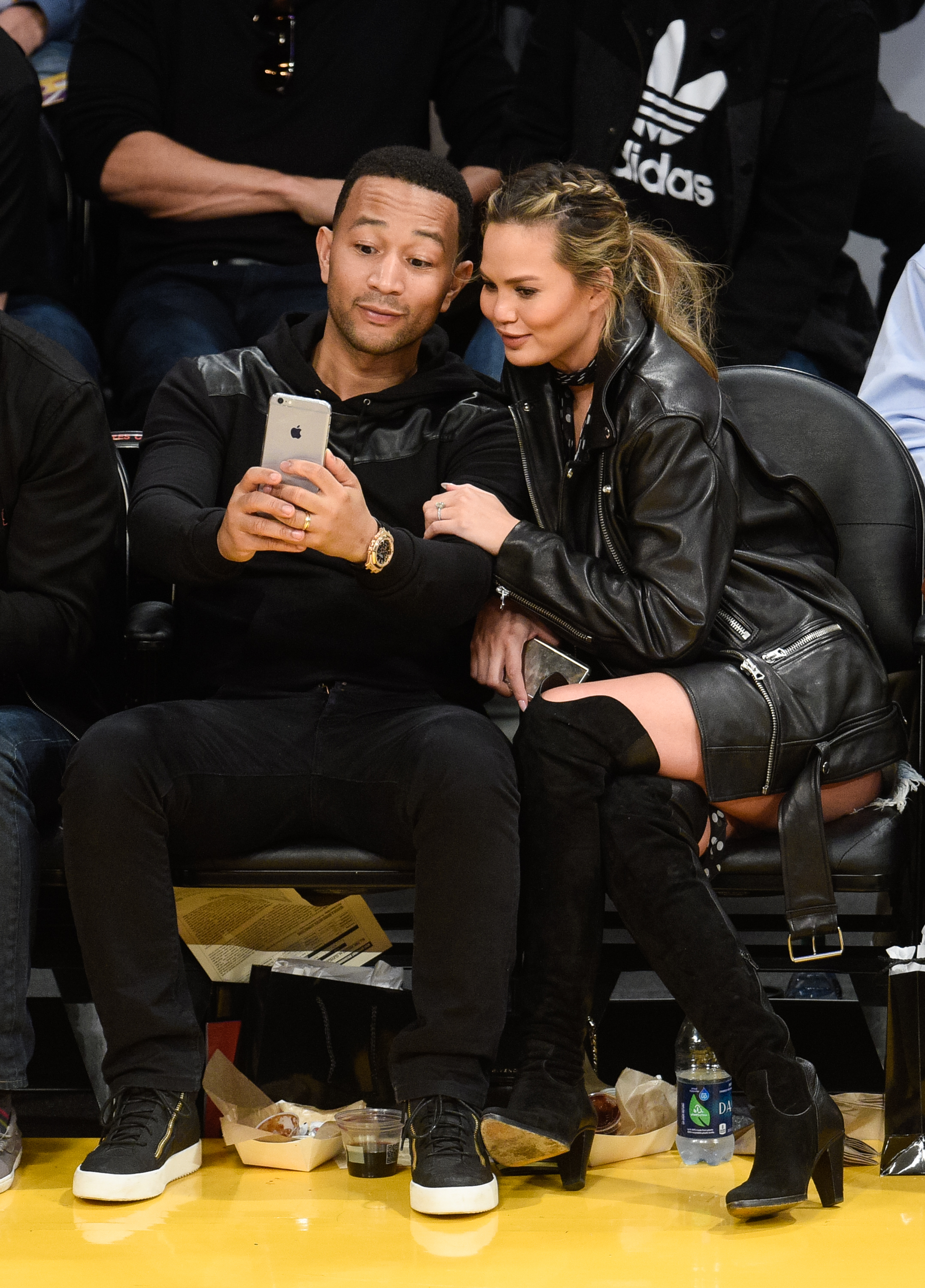 John Legend and Chrissy Teigen at a basketball game in Los Angeles on March 10, 2016.