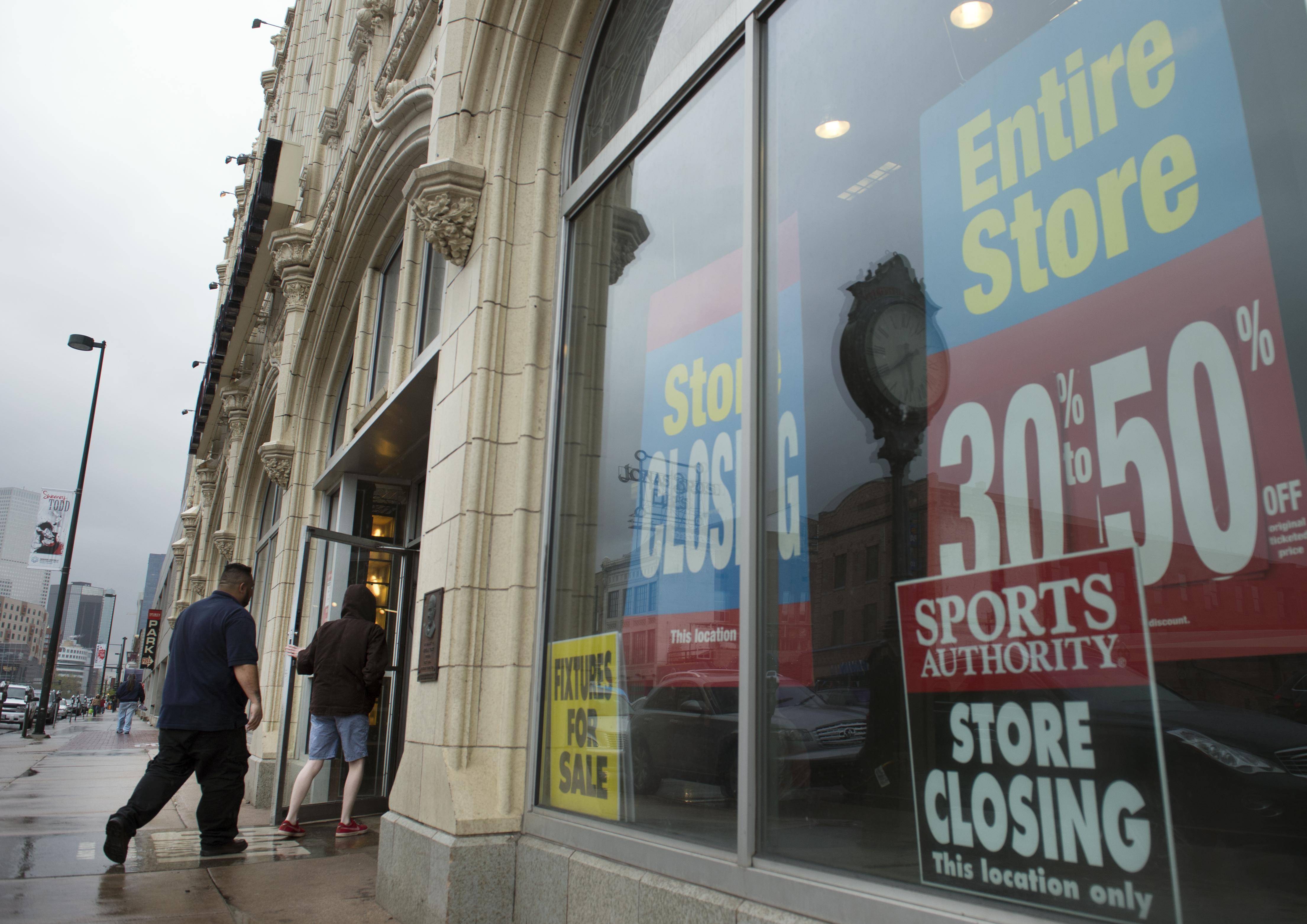 Customers come and go from the Sports Authority flagship 'Sports Castle' in Denver, April 26, 2016