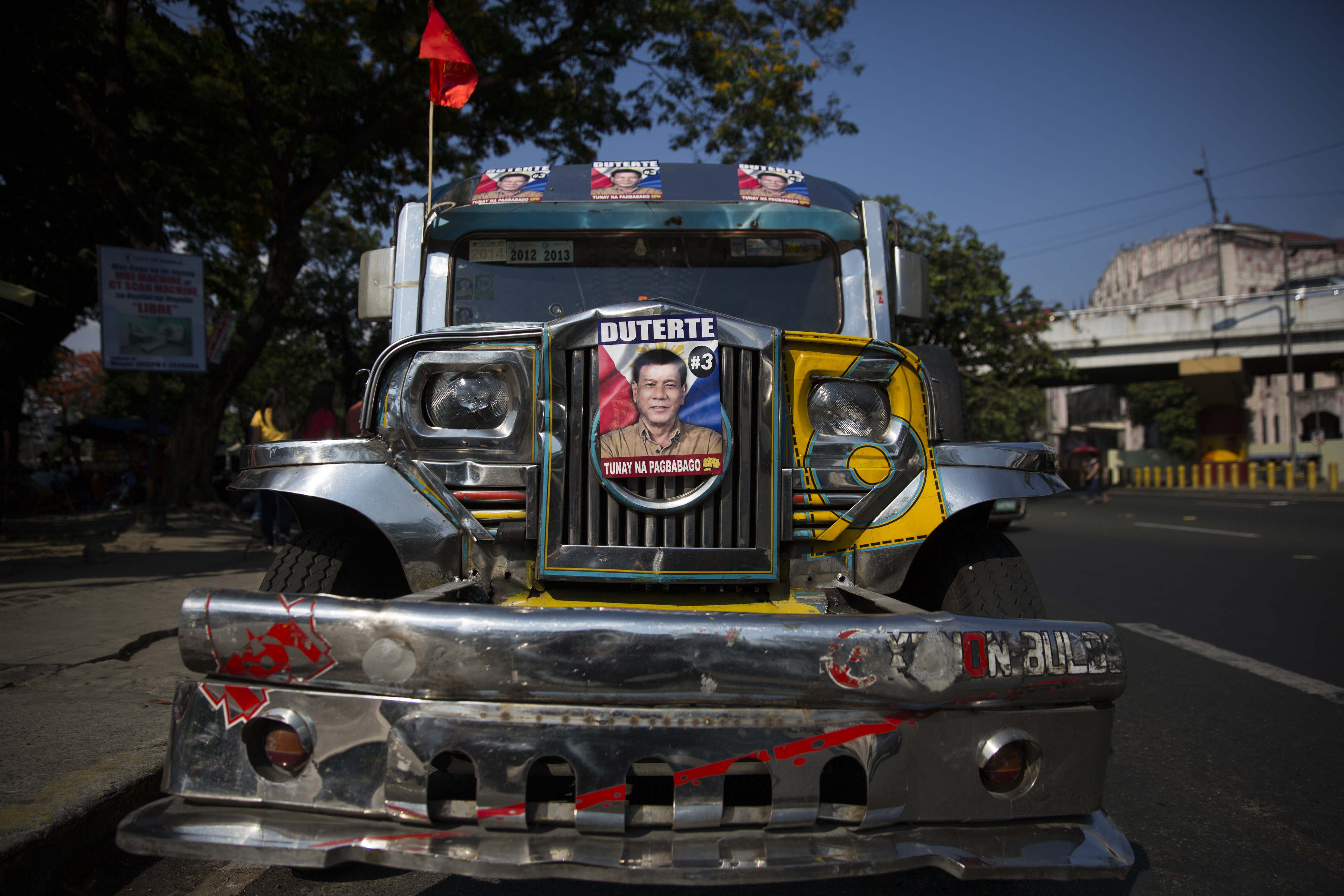 A jeepney, or jeep, is decorated with posters showing the face of Rodrigo Duterte, mayor of Davao City and presidential candidate, at a campaign rally in Manila on May 1, 2016