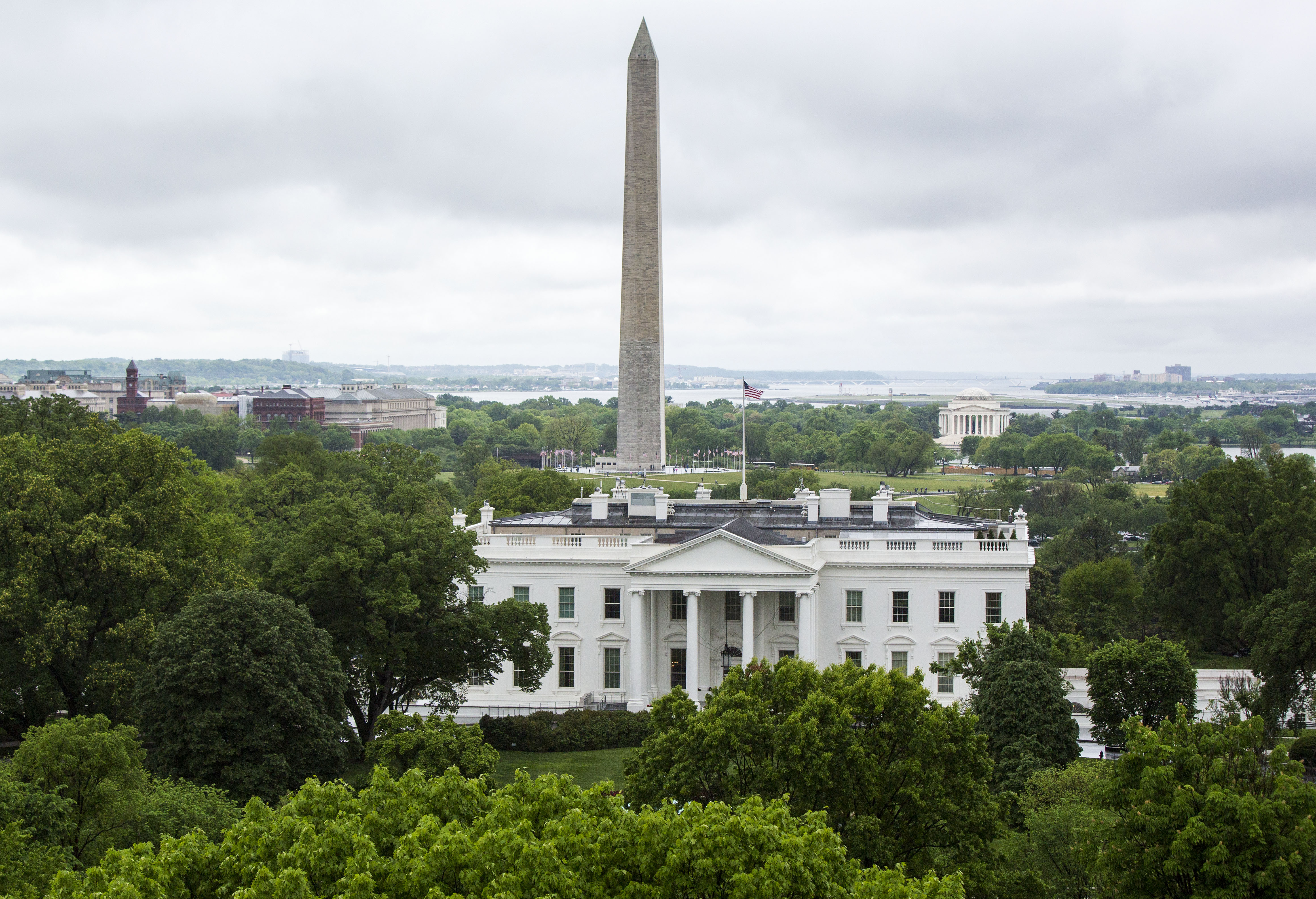 The North Lawn of the White House, the Washington Monument, and the Thomas Jefferson Memorial are seen from the roof of the Hay Adams Hotel, on May 1.