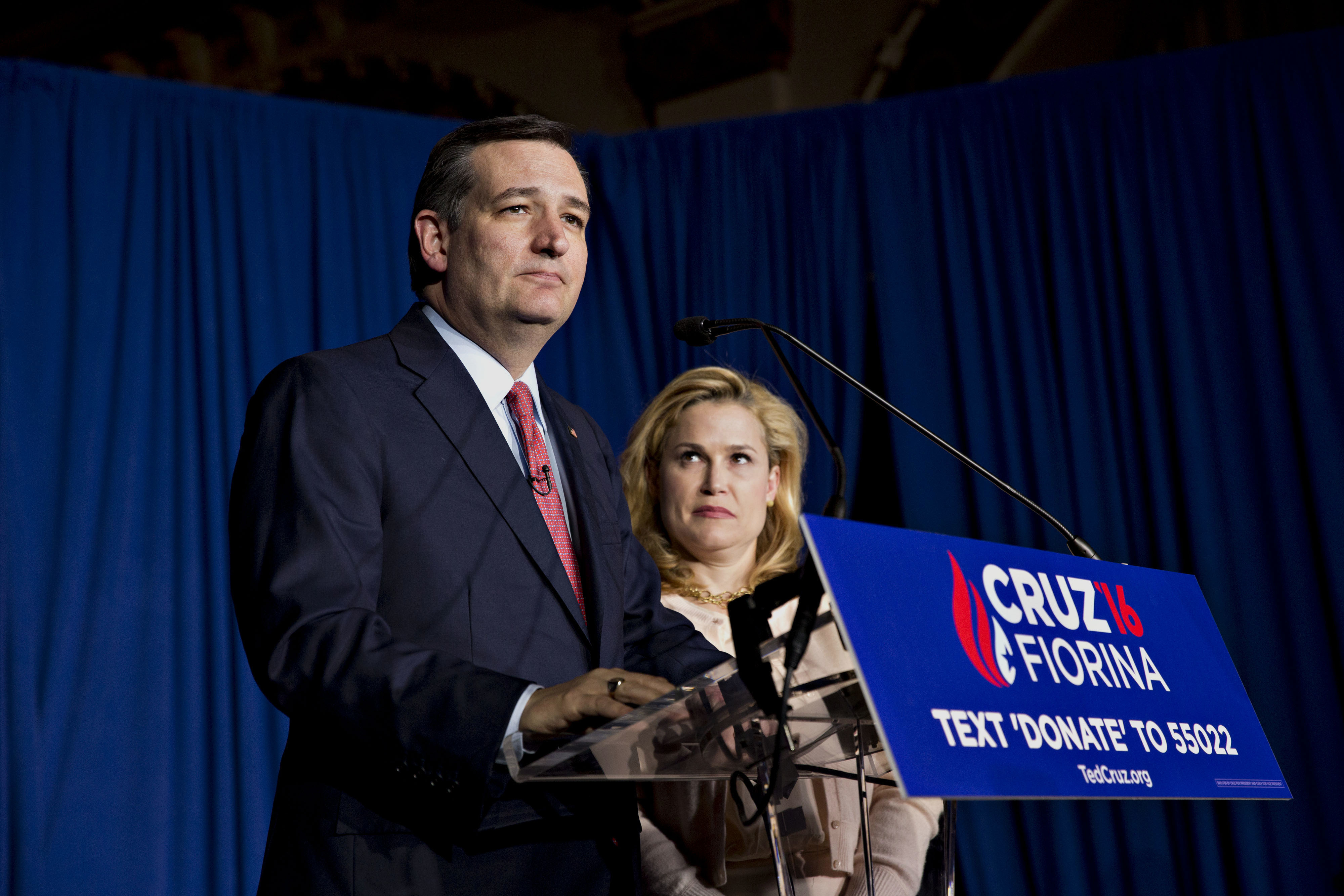 Senator Ted Cruz pauses while speaking as his wife Heidi Cruz looks on during a campaign event in Indianapolis, Indiana, on May 3, 2016.