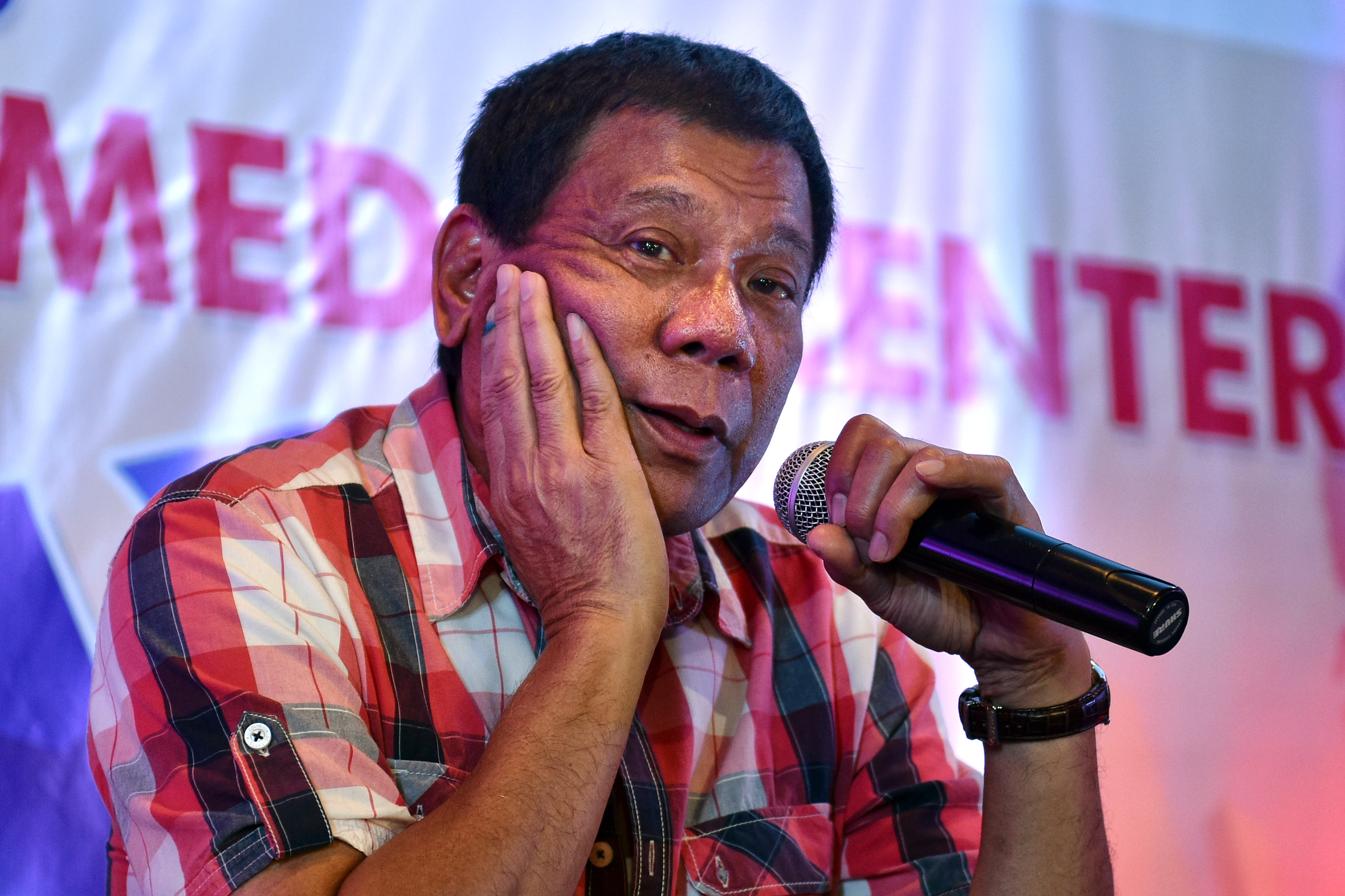 Rodrigo Duterte answers questions from journalists during a press conference on May 10, 2016, in Davao City, the Philippines