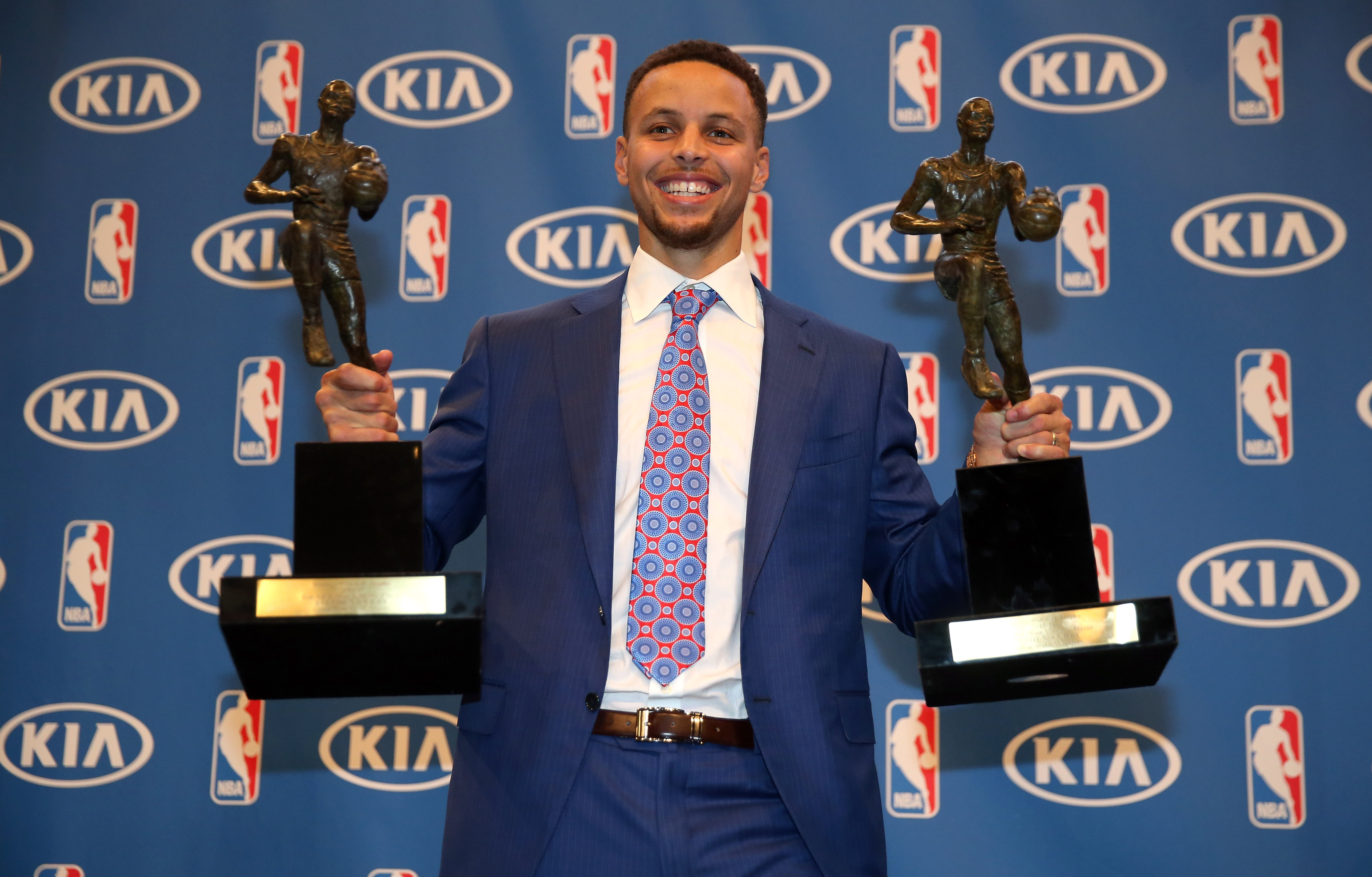 Stephen Curry of the Golden State Warriors poses with his back-to-back NBA Most Valuable Player Awards following a press conference at ORACLE Arena on May 10, 2016 in Oakland, California.