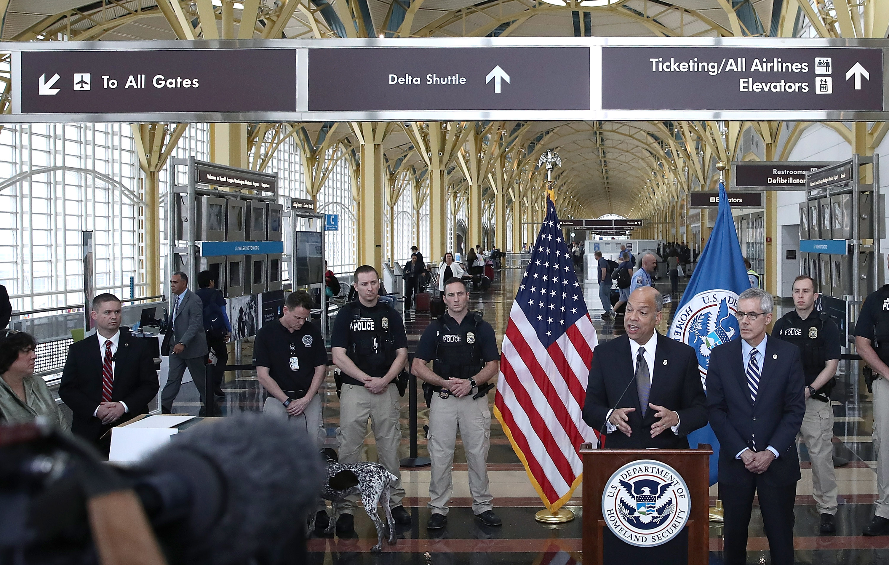 U.S. Homeland Security Secretary Jeh Johnson (L) delivers remarks at Ronald Reagan National Airport May 13, 2016 in Arlington, Virginia. Johnson discussed upcoming summer travel, increased passenger volume, and the ongoing steps taken to protect the safety of travelers. Also pictured is Transportation Security Administration Administrator Peter Neffenger (R). Win McNamee—Getty Images