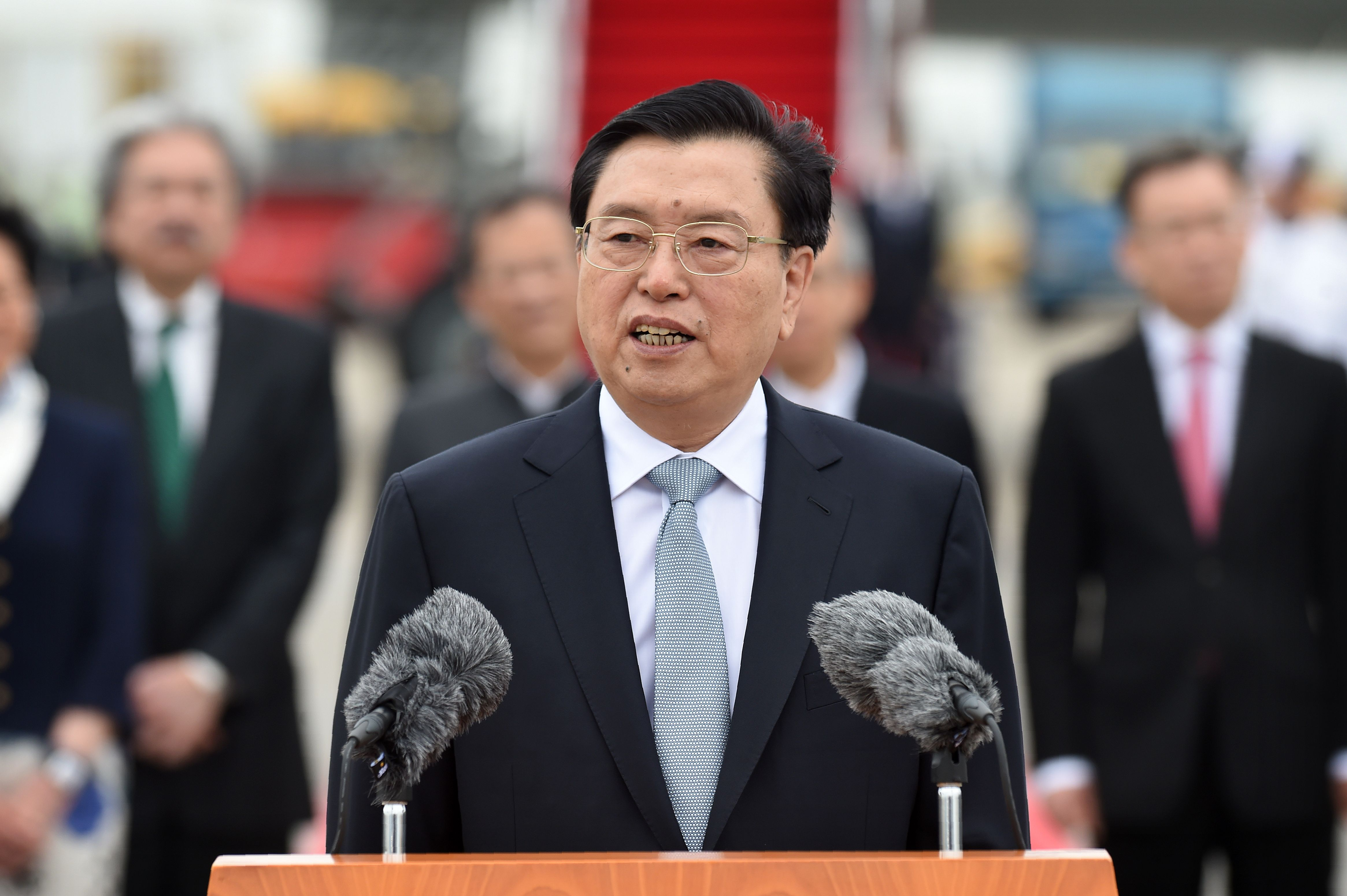 China's National People's Congress Standing Committee chairman Zhang Dejiang speaks to the media after arriving at Hong Kong's International Airport on May 17, 2016.