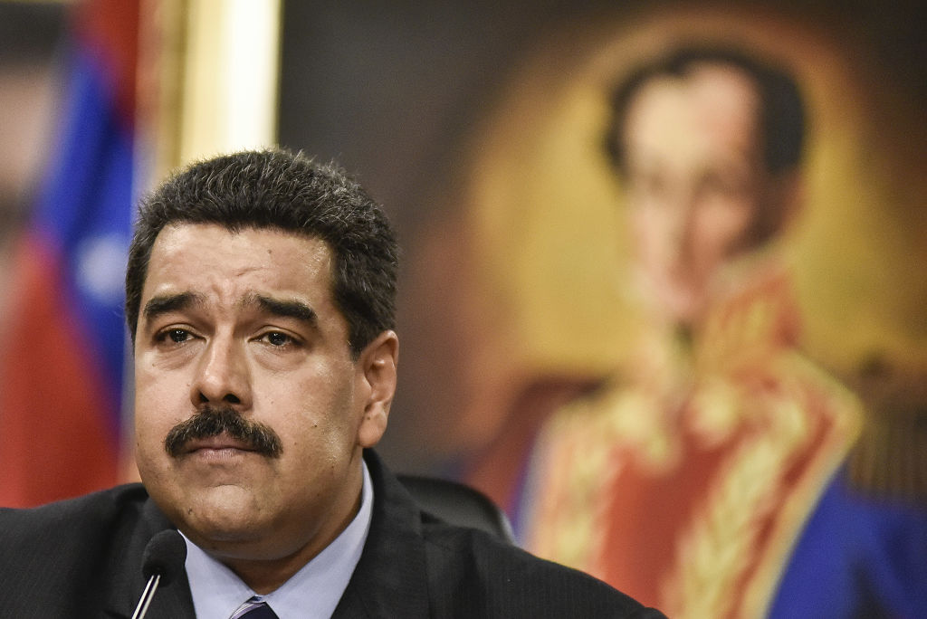 Nicolas Maduro, Venezuela's president, pauses while speaking during a news conference in Caracas, Venezuela, on Tuesday, May 17, 2016. Earlier this month, Venezuela's opposition said it had cleared the first hurdle in a drive to remove Maduro from office. The opposition says almost 2 million people signed a petition calling for a recall process to start, far outstripping the 200,000 required by law. Photographer: Carlos Becerra/Bloomberg via Getty Images