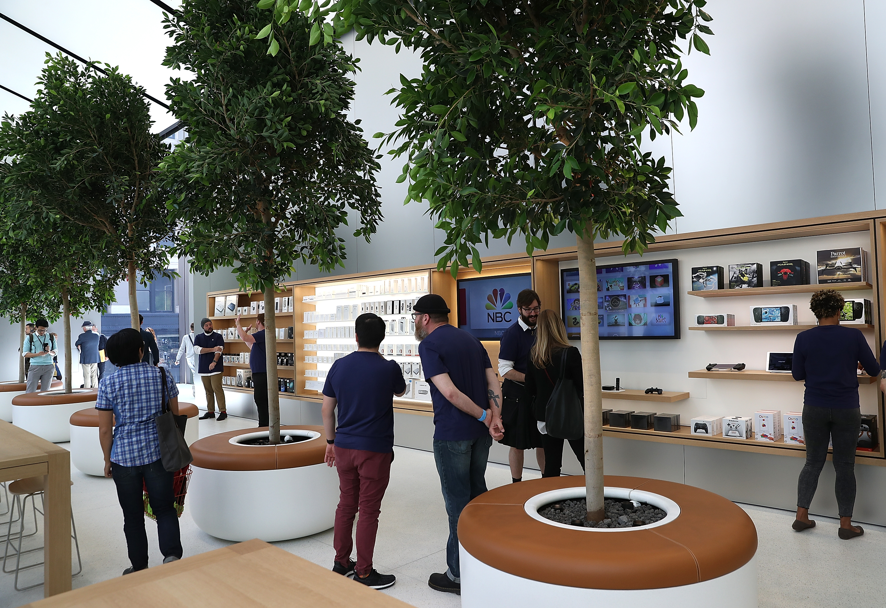 Members of media tour the  Genius Grove  during a press preview of the new flagship Apple Store on May 19, 2016 in San Francisco, California.