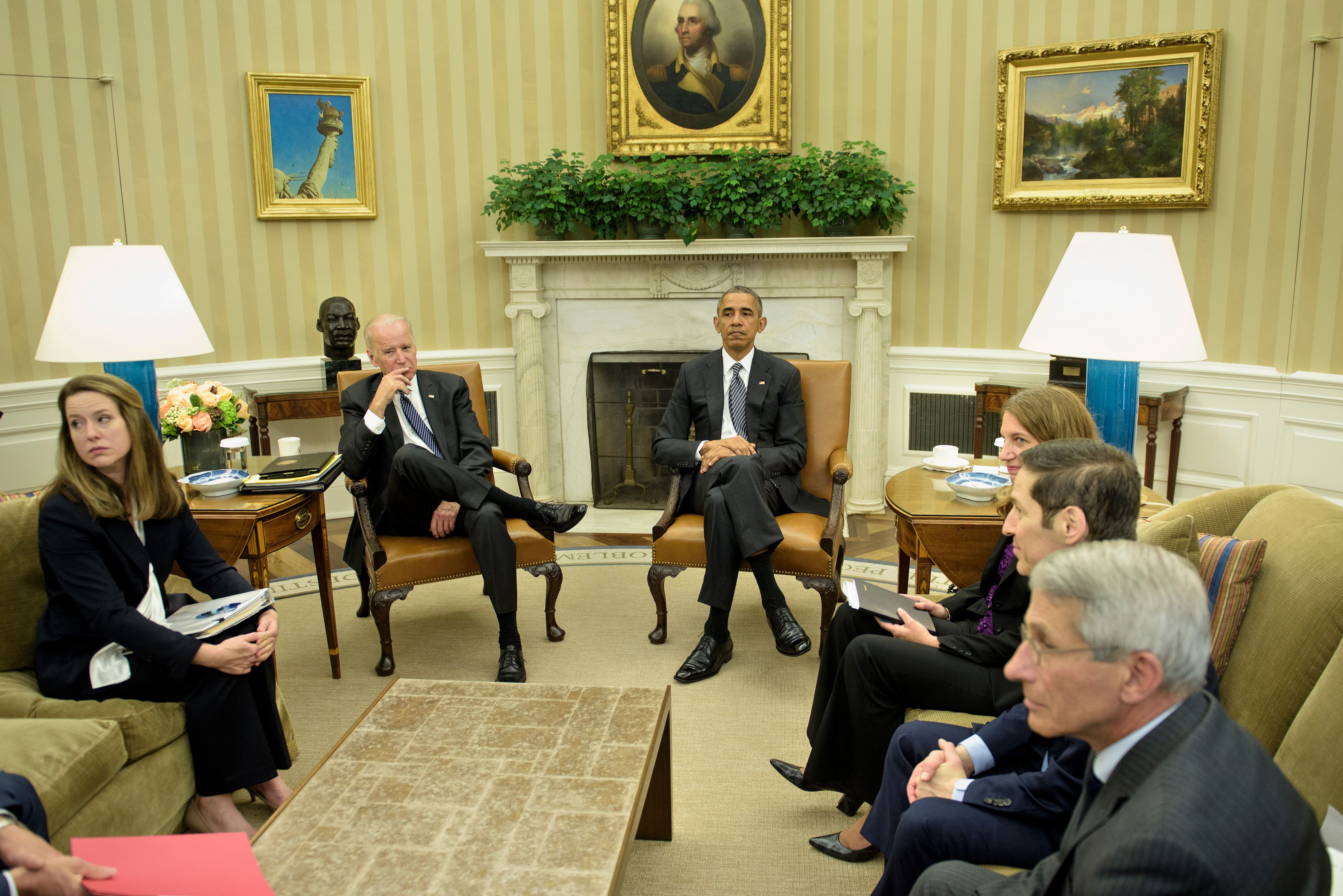 (L-R) Amy Pope, Deputy Homeland Security Advisor, US Vice President Joe R. Biden, US President Barack Obama, US Secretary of Health and Human Services Sylvia Burwell, National Institute of Allergy and Infectious Diseases Director Dr. Anthony Fauci, and Centers for Disease Control and Prevention Director Dr. Tom Frieden wait after a meeting about the Zika virus in the Oval Office of the White House BRENDAN SMIALOWSKI—AFP/Getty Images